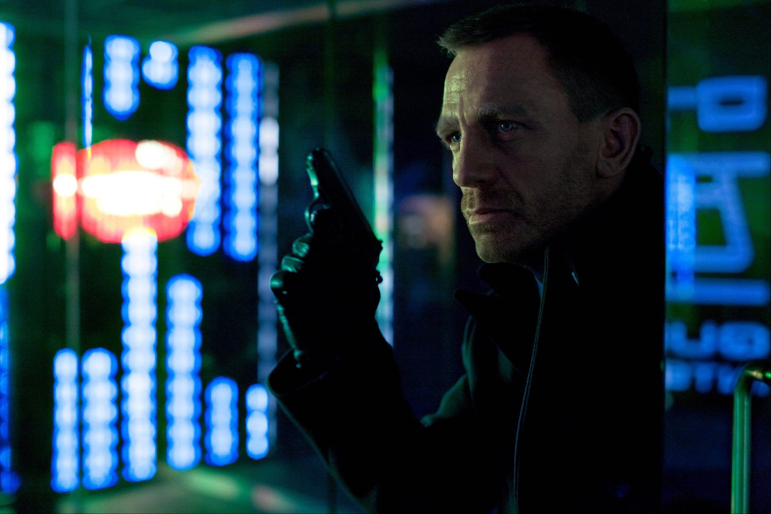"This publicity film image released by Columbia Pictures shows Daniel Craig as James Bond in the action adventure film, ""Skyfall."""