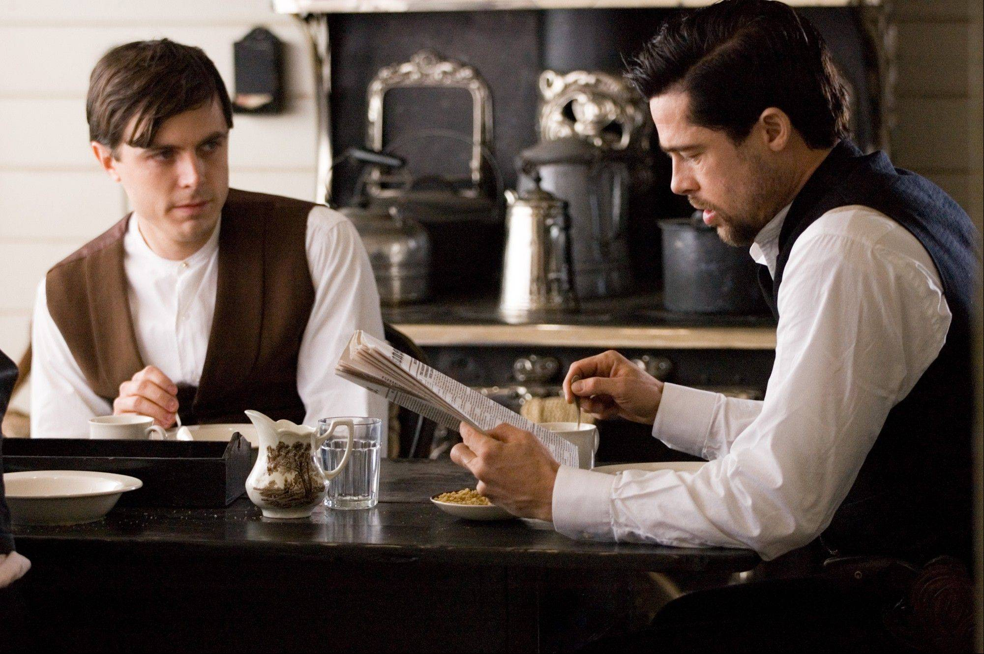 "This publicity file photo provided by Warner Bros. shows Casey Affleck, left, and Brad Pitt in ""The Assassination of Jesse James by the Coward Robert Ford."""