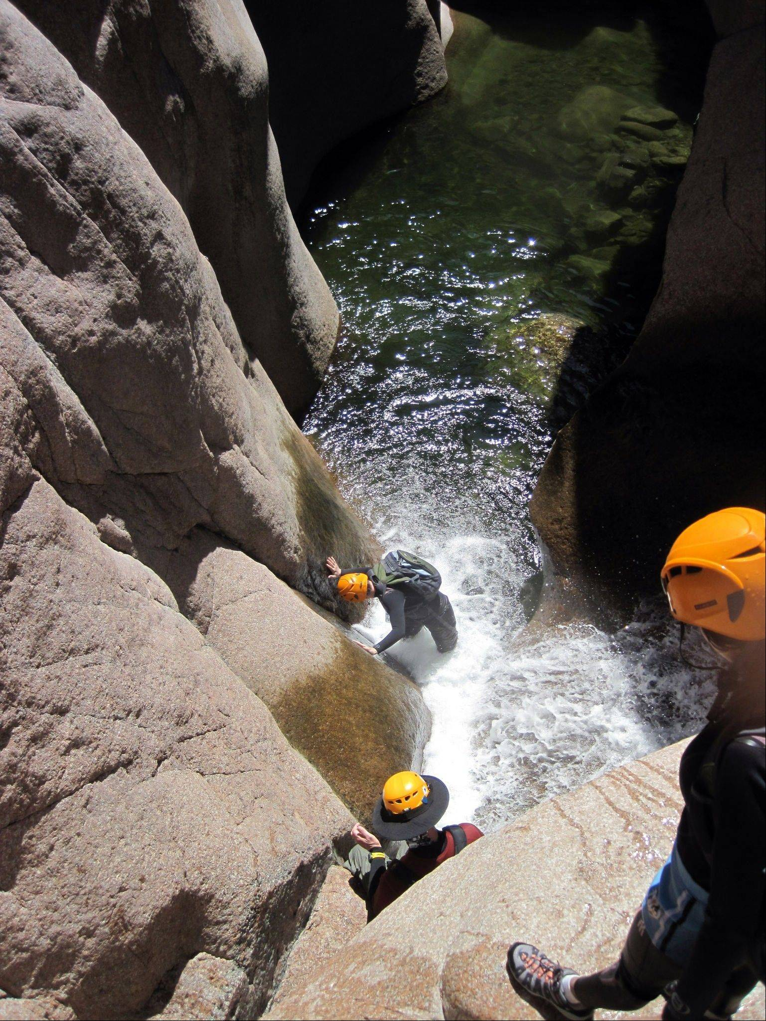 The sport of canyoneering includes hiking, climbing, sliding and wetsuit-wading.
