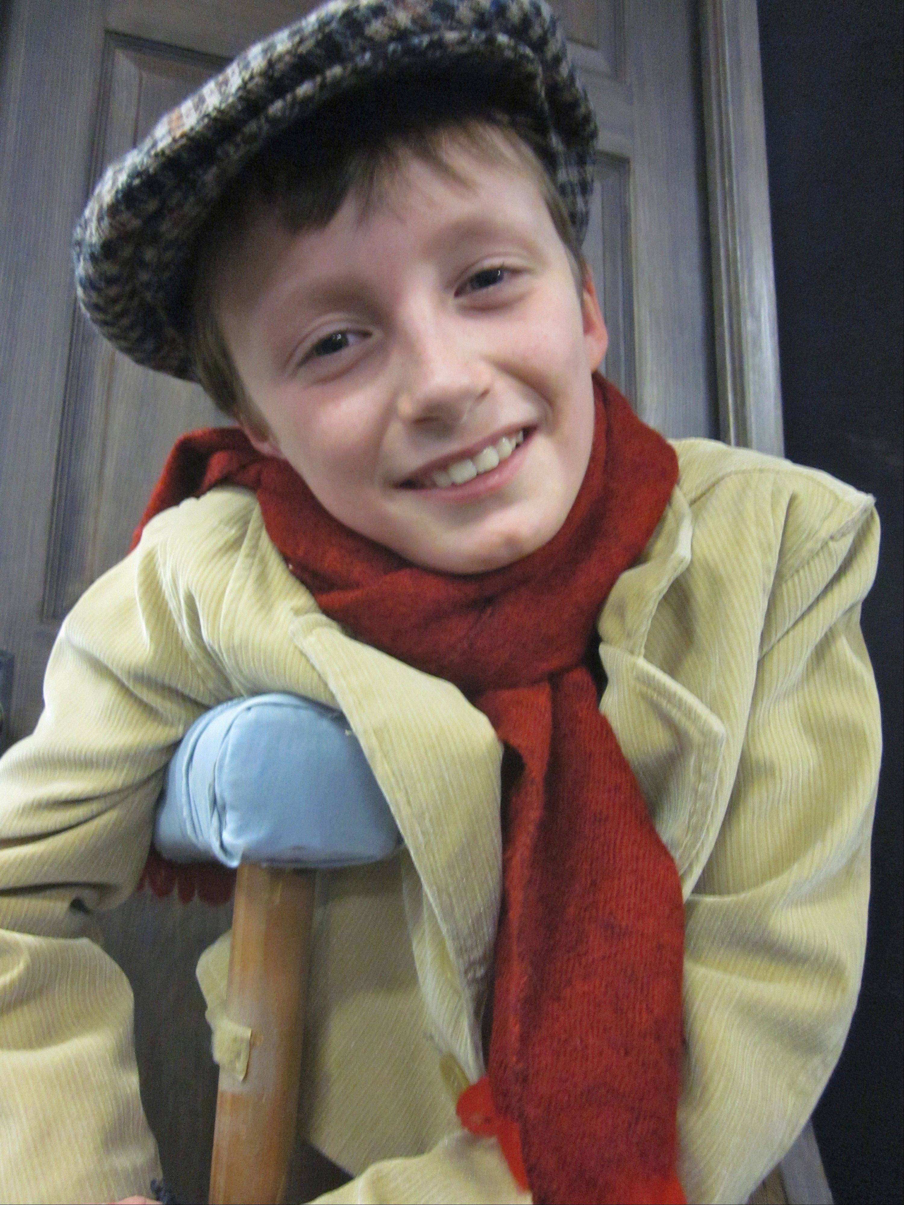 "Eight-year-old Killian Hughes is one of two cast members playing Tiny Tim in the Drury Lane Theater for Young Audiences production of ""A Christmas Carol."""