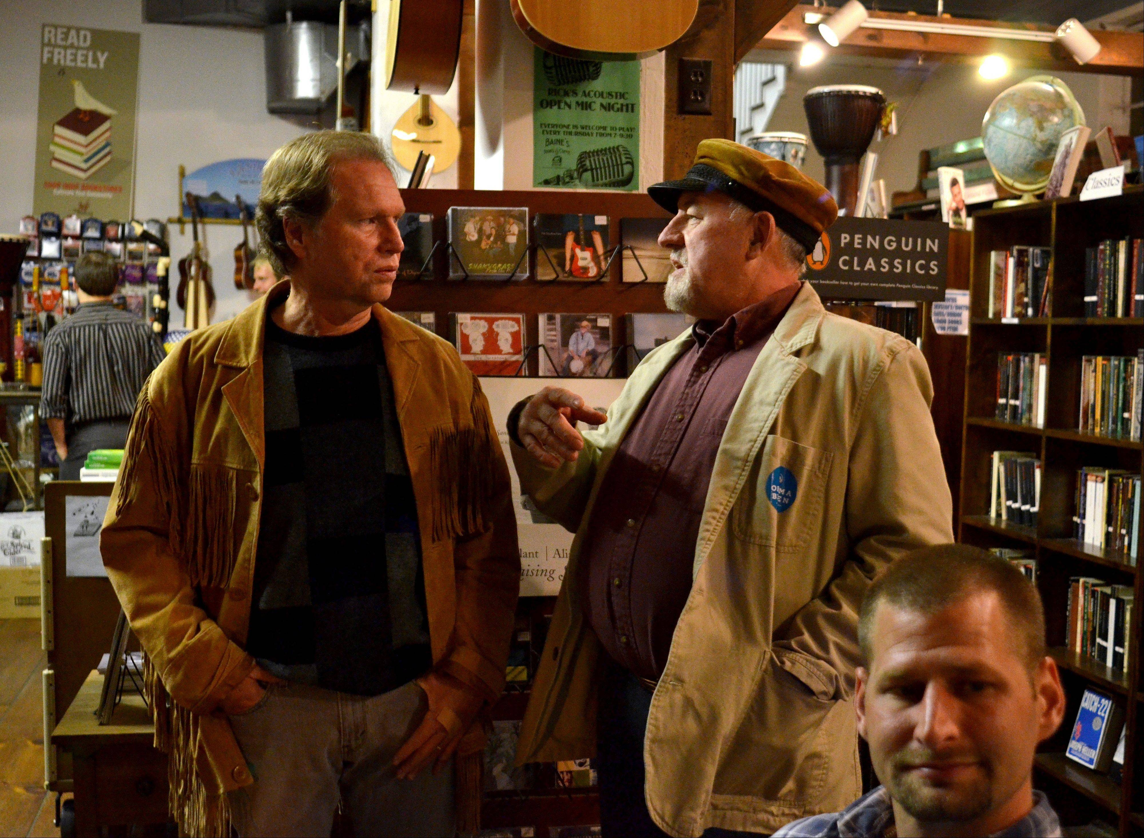 Jim Elder, center, talks with a friend during open mic night at Baine's Books in Appomattox, Va.