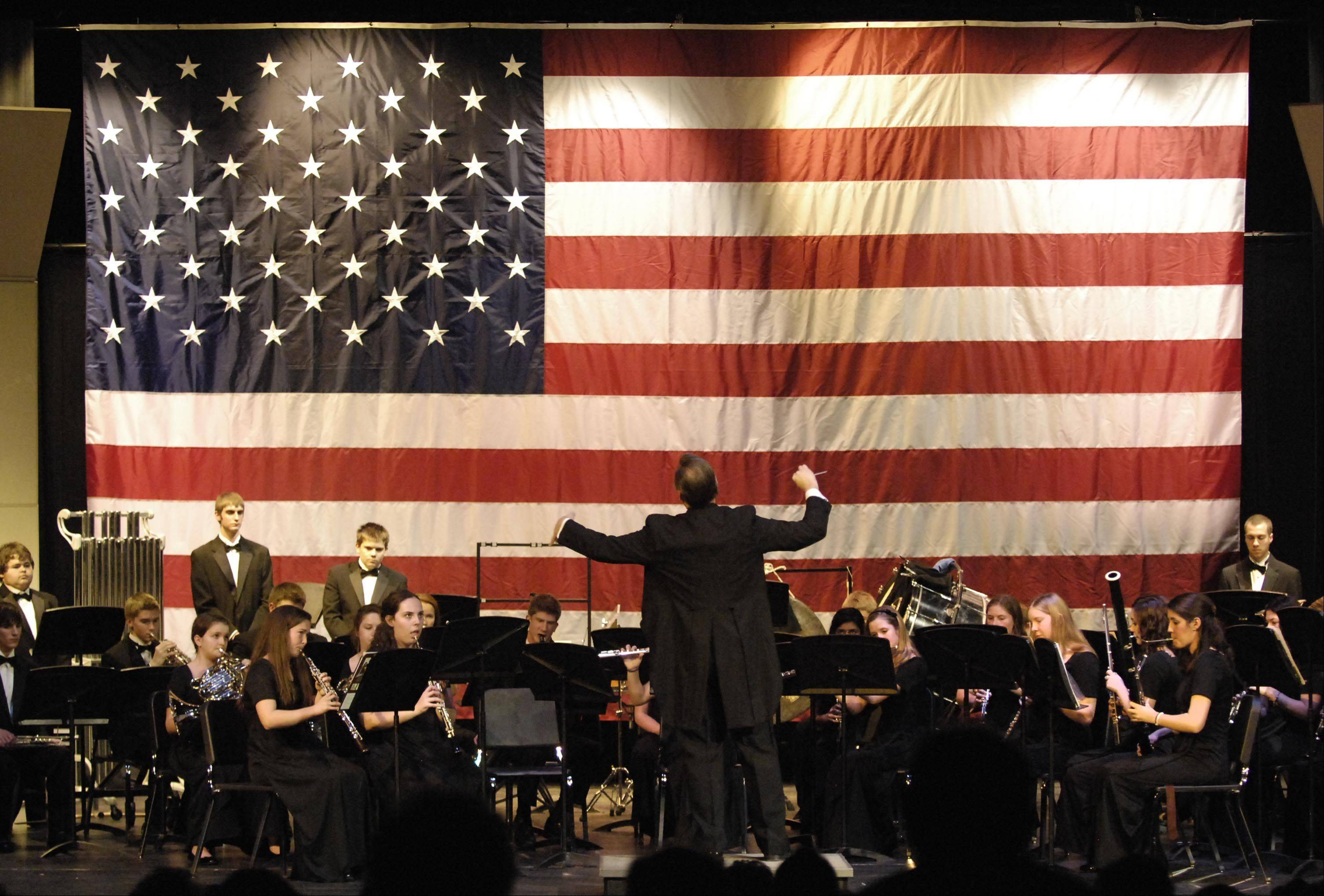 Conductor Brian Wis leads the Wind Symphony Sunday at the Sixth Annual Veterans Celebration Concert for Veterans Day at St. Charles North High School.