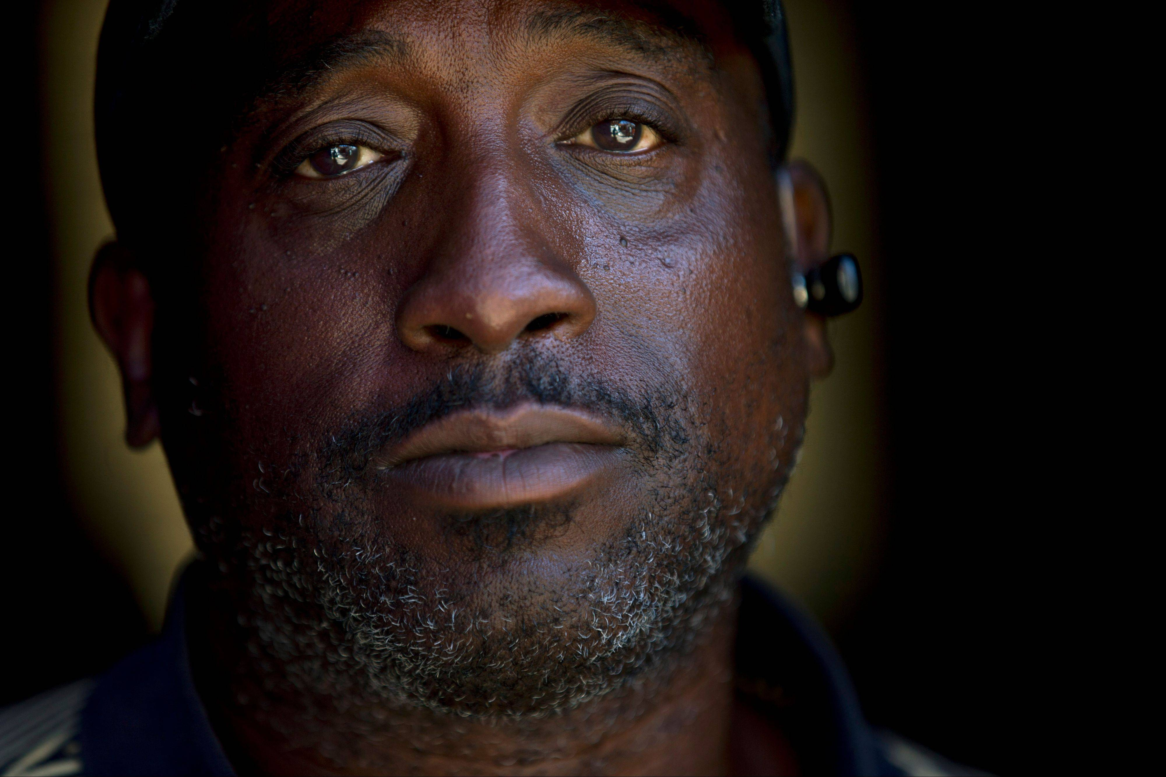 In this Sept. 19, 2012 picture, homeless veteran Jerome Belton poses for a portrait at a homeless shelter in San Diego. A former Marine, Belton now lives on the streets in San Diego. Despite budget increases and an aggressive strategy, the Obama administration struggles to make good on its audacious promise: End homelessness among veterans by 2015.