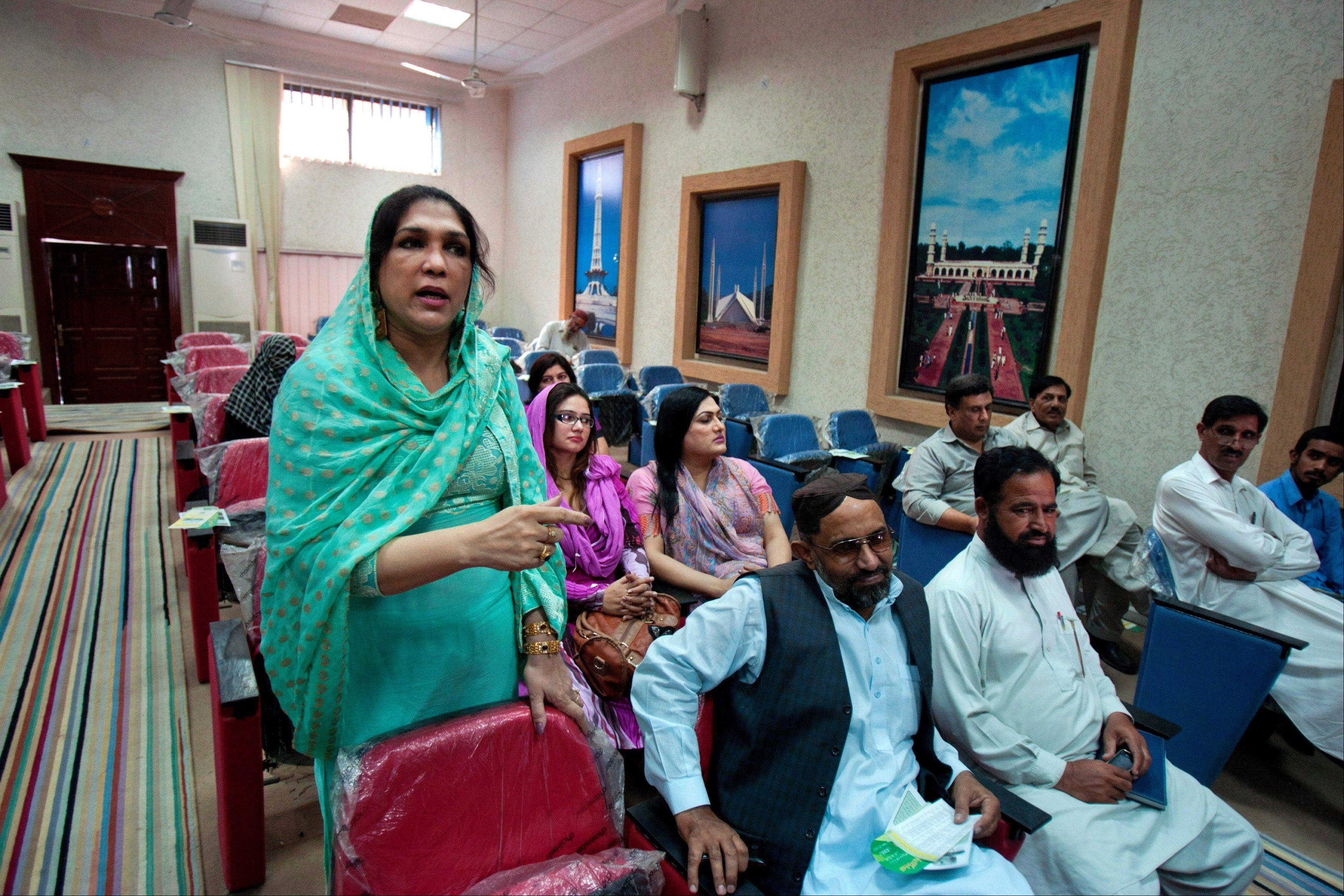Almas Bobby, 42, left, the head of Pakistan's transgender community, speaks at a seminar organized by the Pakistan Election Commission to obtain suggestions for upcoming general election in Rawalpindi, Pakistan.