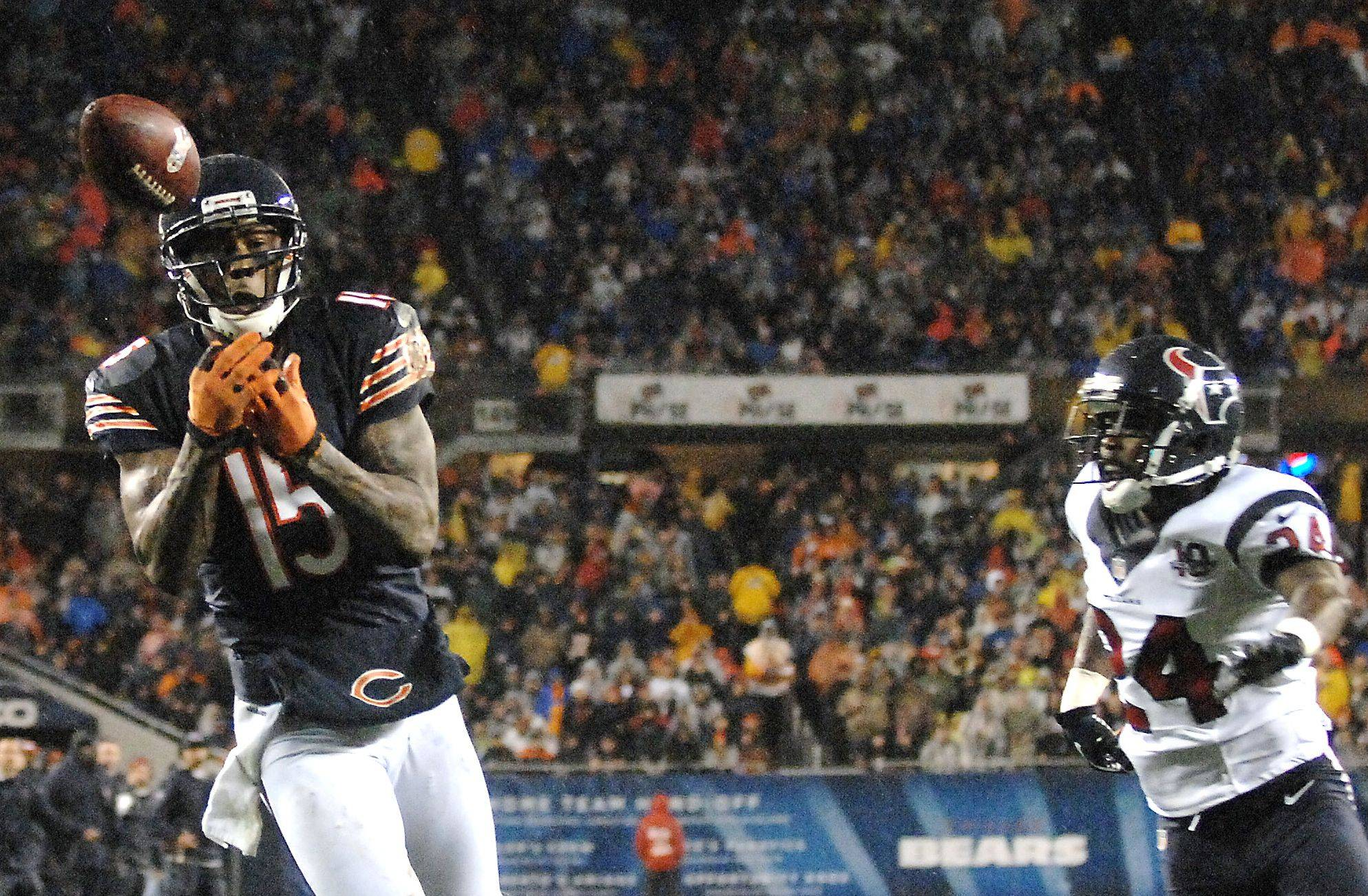 Brandon Marshall drops what appears to be a sure touchdown during the second quarter after beating cornerback Johnathan Joseph on Sunday at Soldier Field.