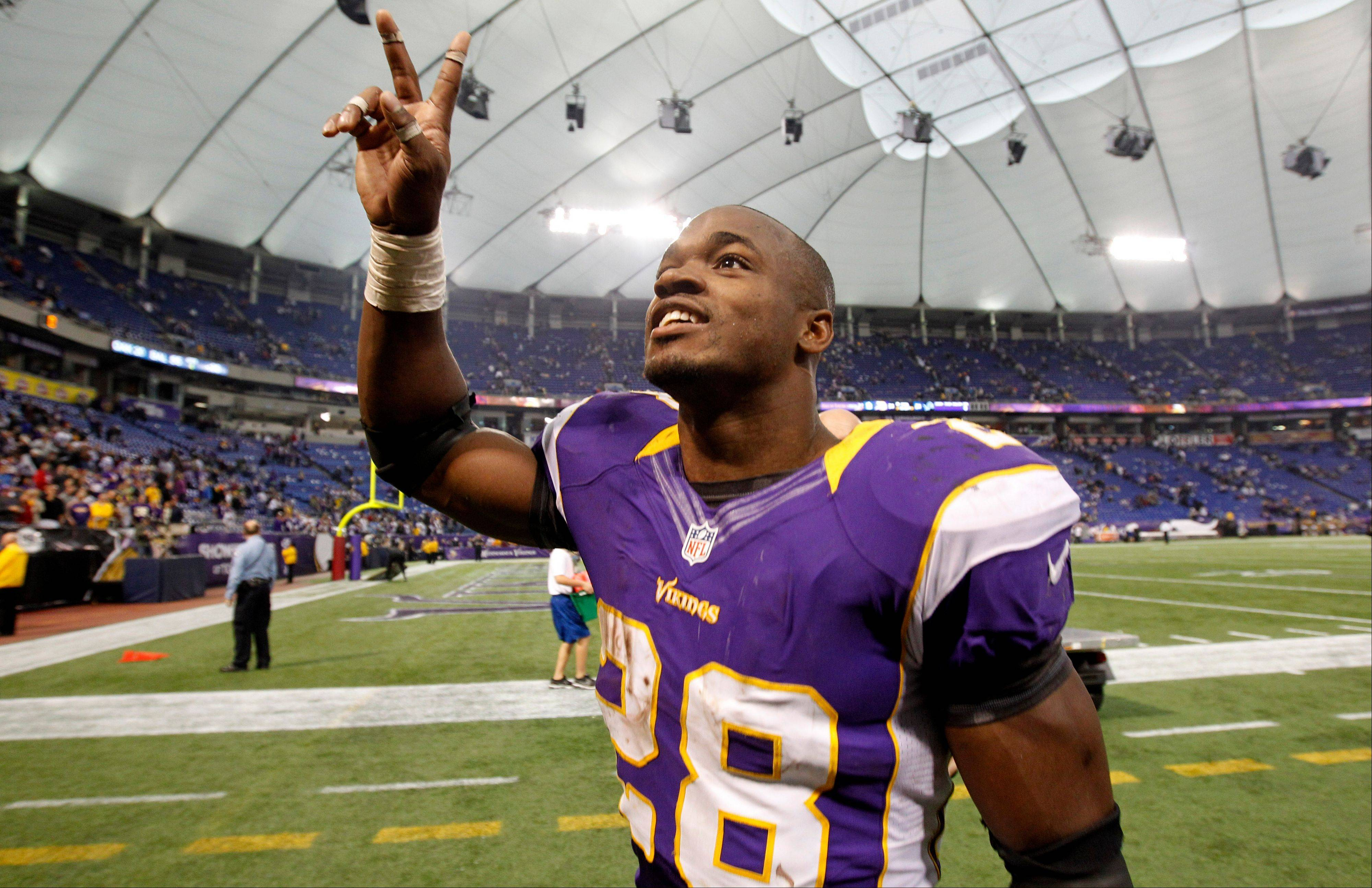 Minnesota Vikings running back Adrian Peterson celebrates after an NFL football game against the Detroit Lions, Sunday, Nov. 11, 2012, in Minneapolis. The Vikings won 34-24.