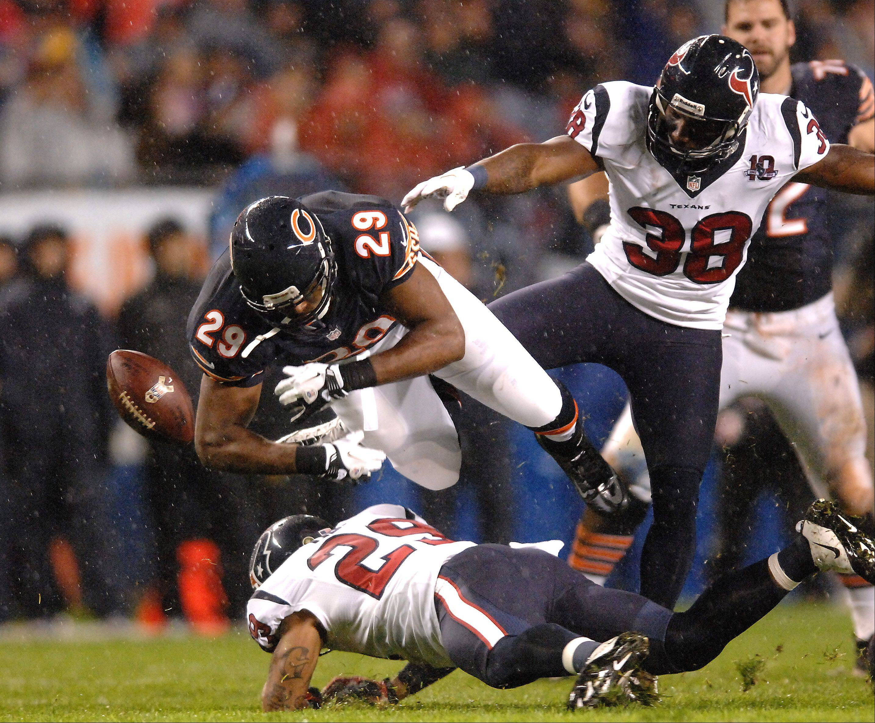 Chicago Bears running back Michael Bush (29) fumbles on a fourth down run in the first quarter against Houston Texans during Sunday's game at Soldier Field in Chicago.