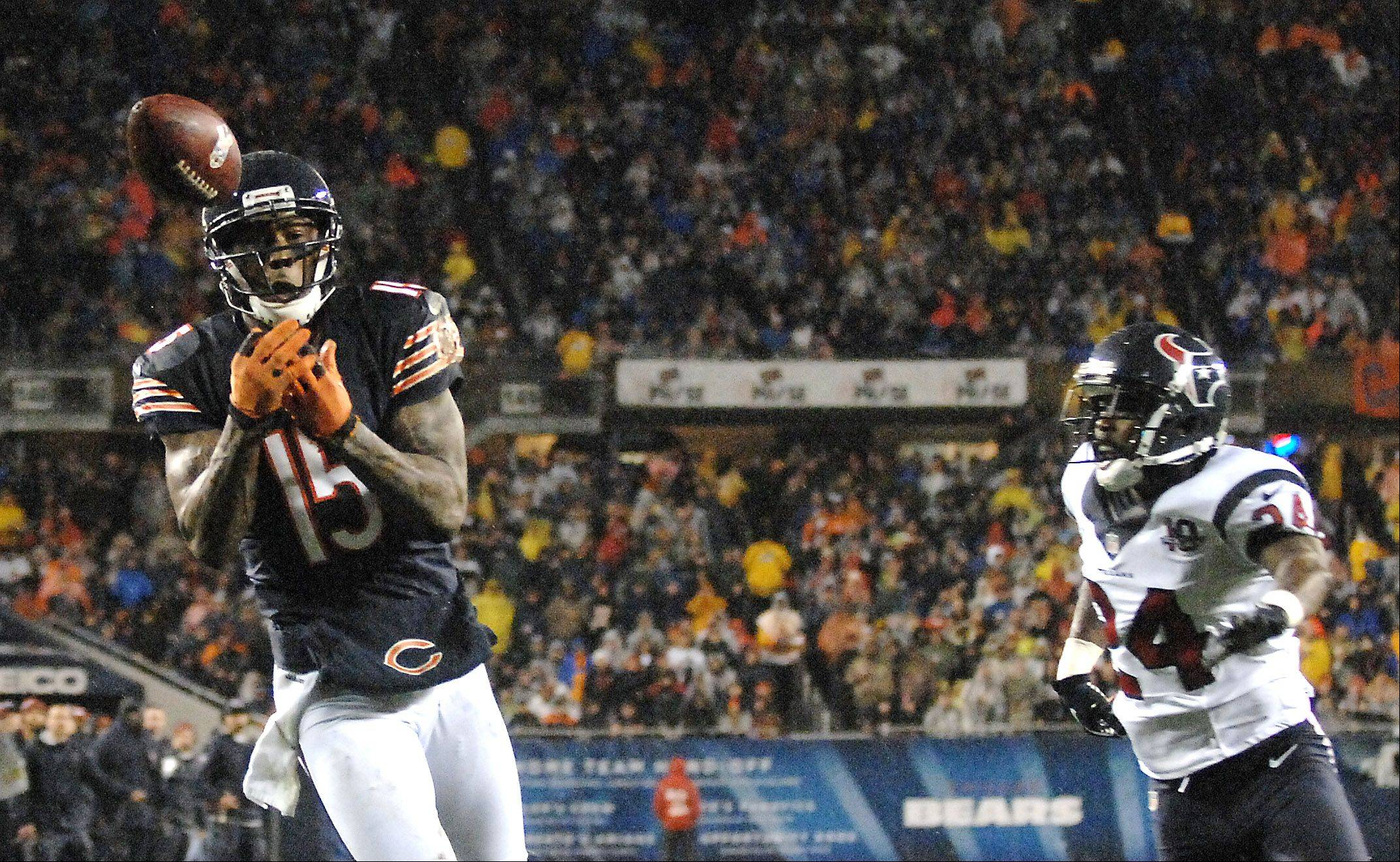 Chicago Bears wide receiver Brandon Marshall (15) drops what appears to be a sure touchdown during the second quarter after beating Houston Texans cornerback Johnathan Joseph (24) downfield during Sunday's game.
