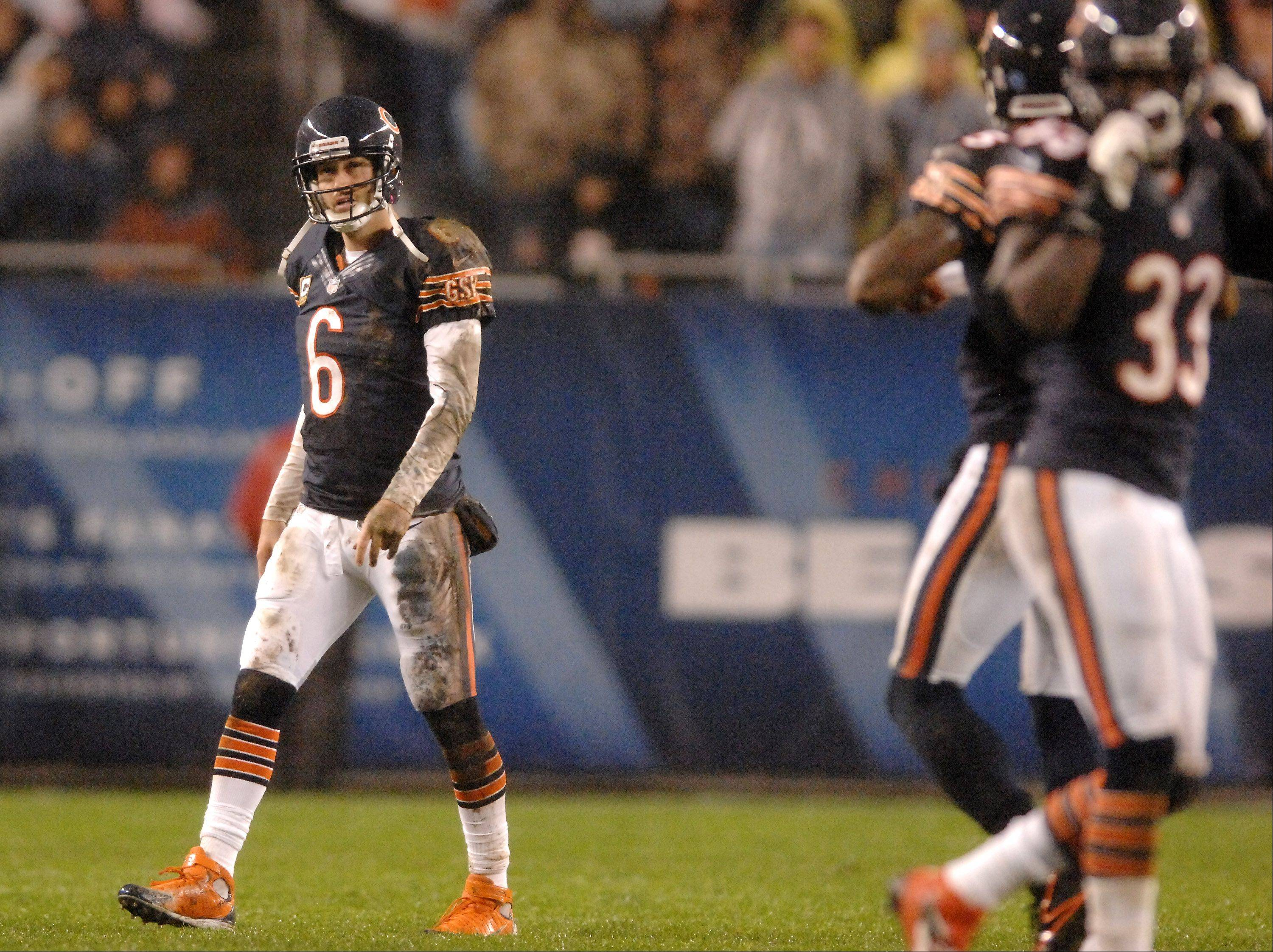 Chicago Bears quarterback Jay Cutler (6) walks off the field after his second first half interception.