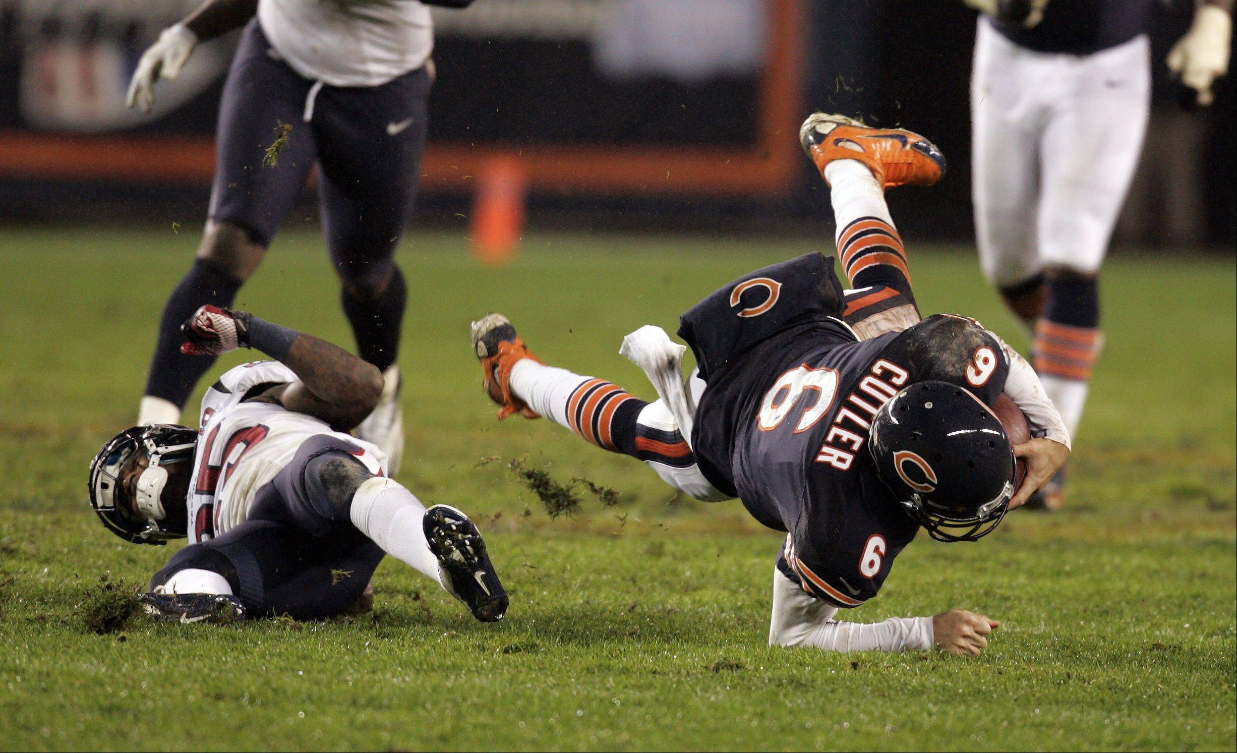 Chicago Bears quarterback Jay Cutler (6) gets hit hard by Houston Texans cornerback Kareem Jackson (25) late in the first half.