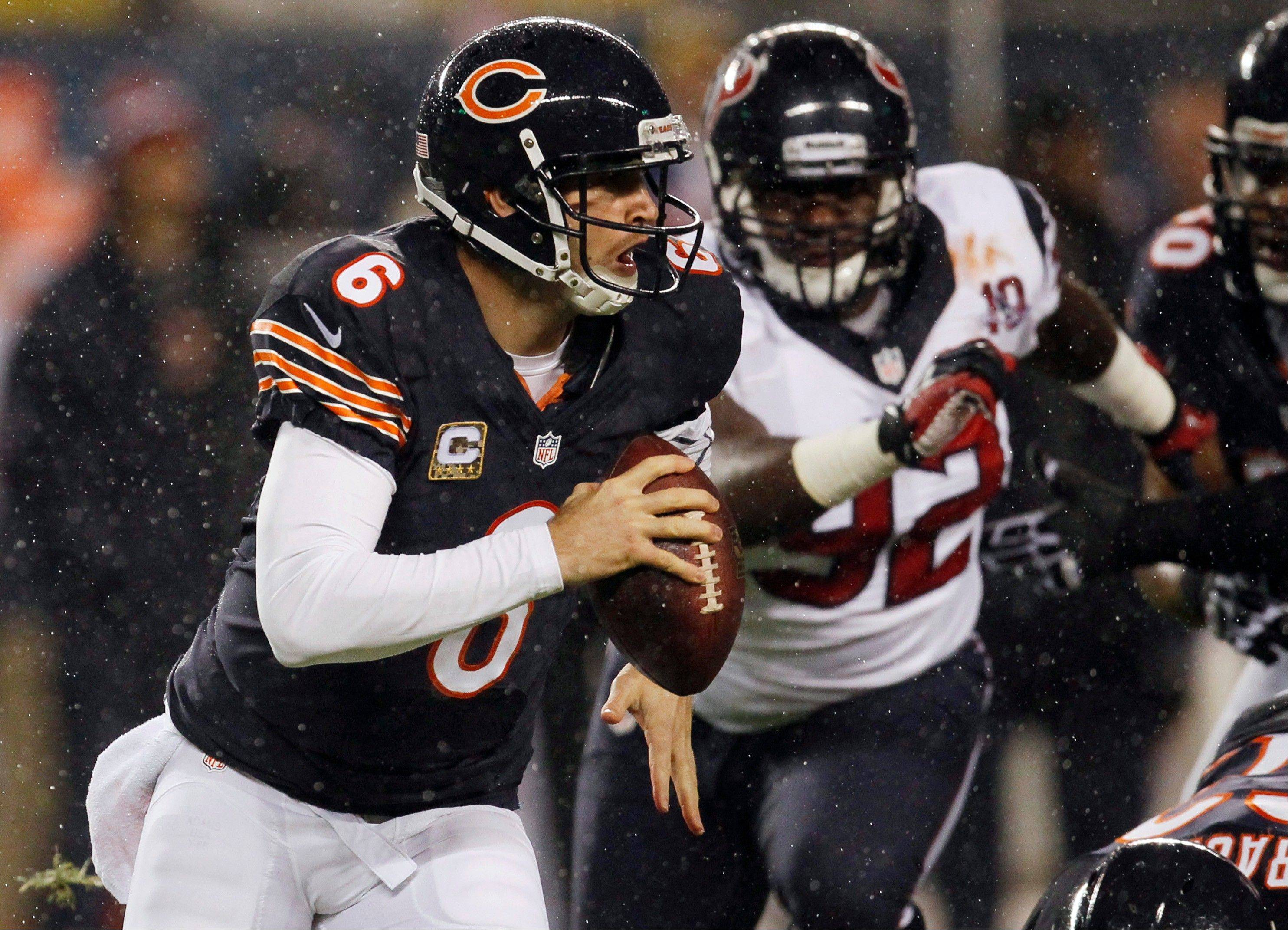 Chicago Bears quarterback Jay Cutler (6) scrambles away from Houston Texans defensive tackle Earl Mitchell (92) during the first half.