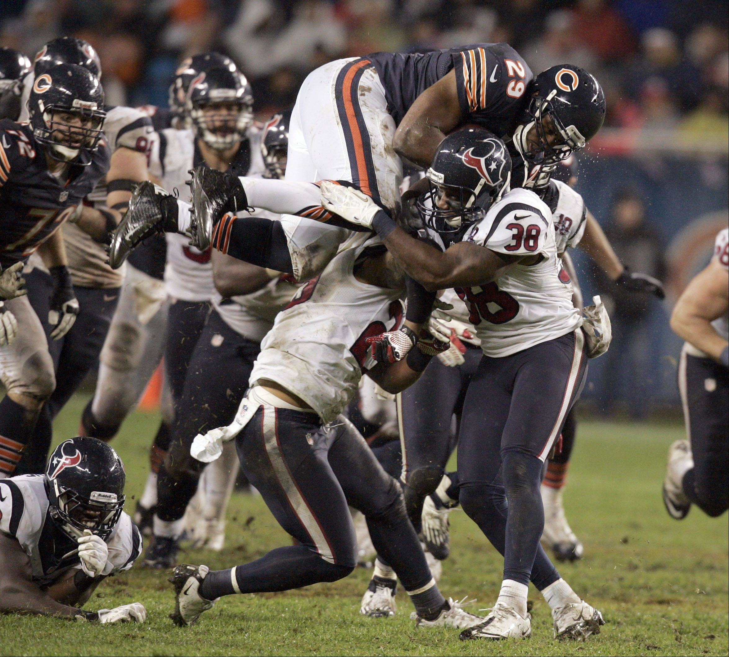 Chicago Bears running back Michael Bush (29) gets up ended by Houston Texans free safety Danieal Manning (38) during the game.