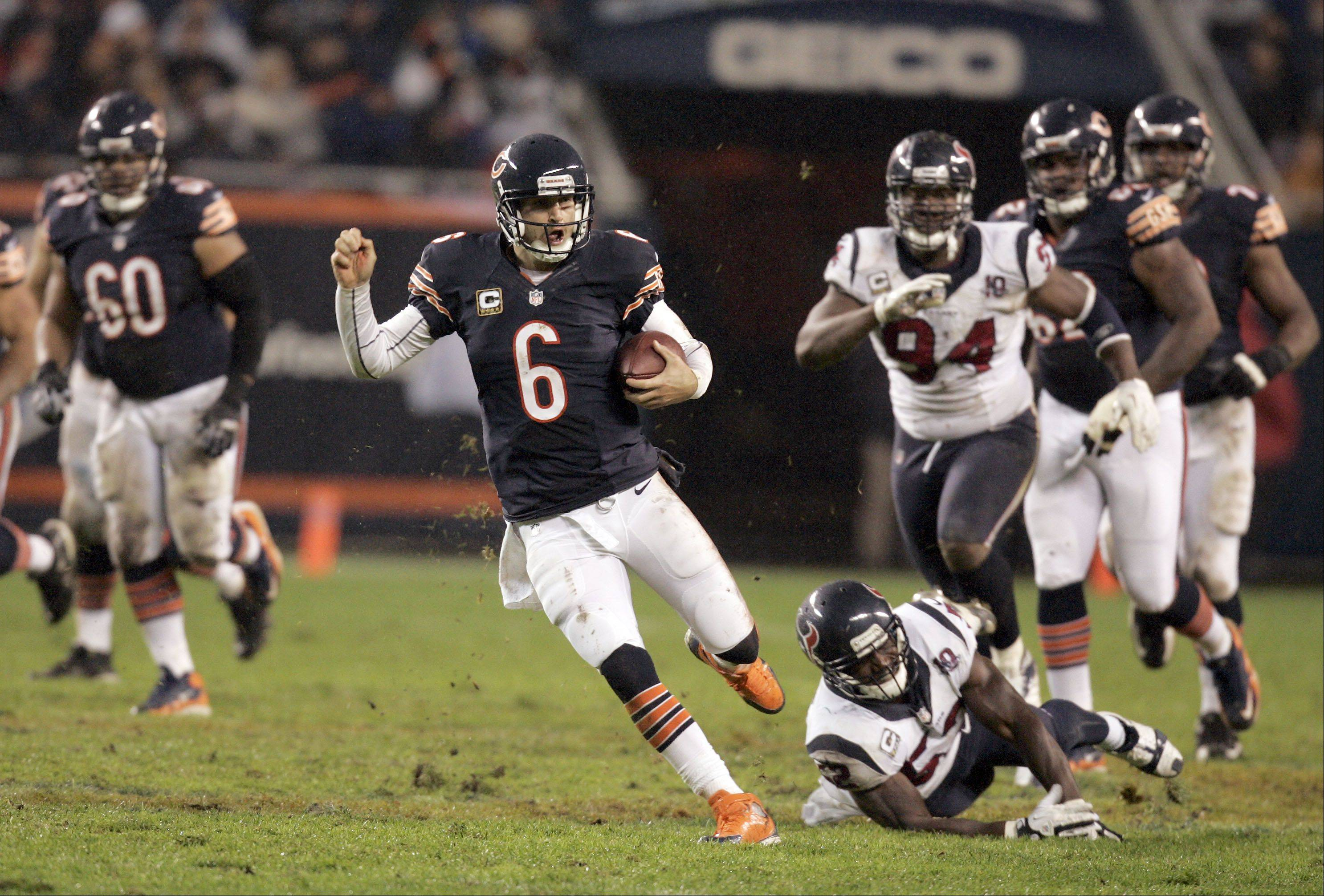 Chicago Bears quarterback Jay Cutler (6) gains some yards in the second quarter during the game.