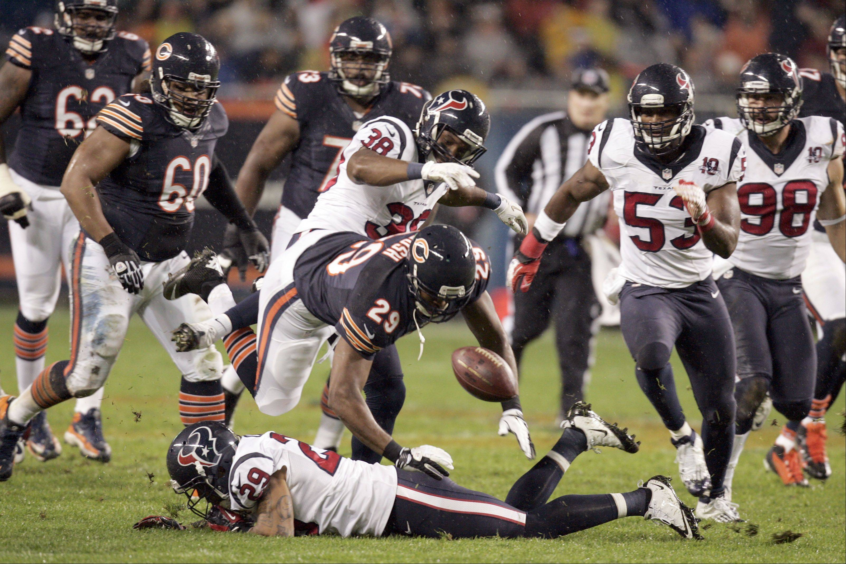 Chicago Bears running back Michael Bush (29) loses the ball during the game.