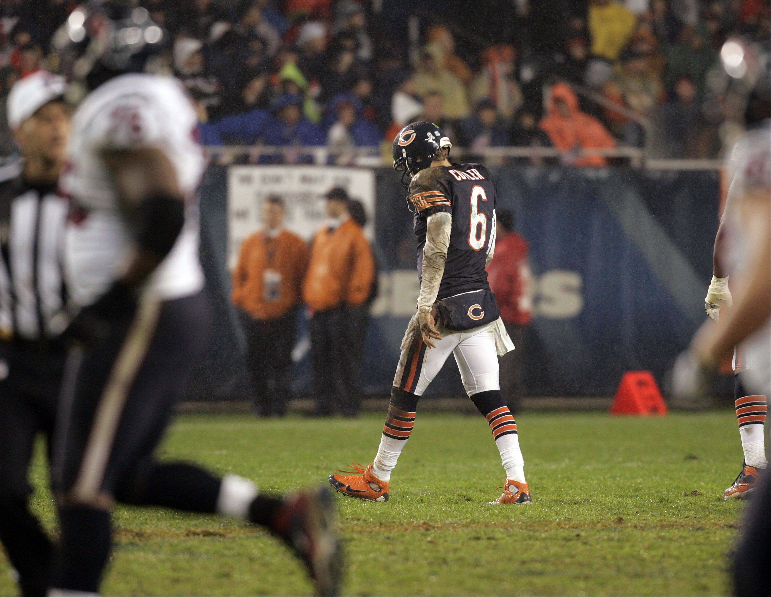 Chicago Bears quarterback Jay Cutler (6) walks off the field after another interception in the second quarter.