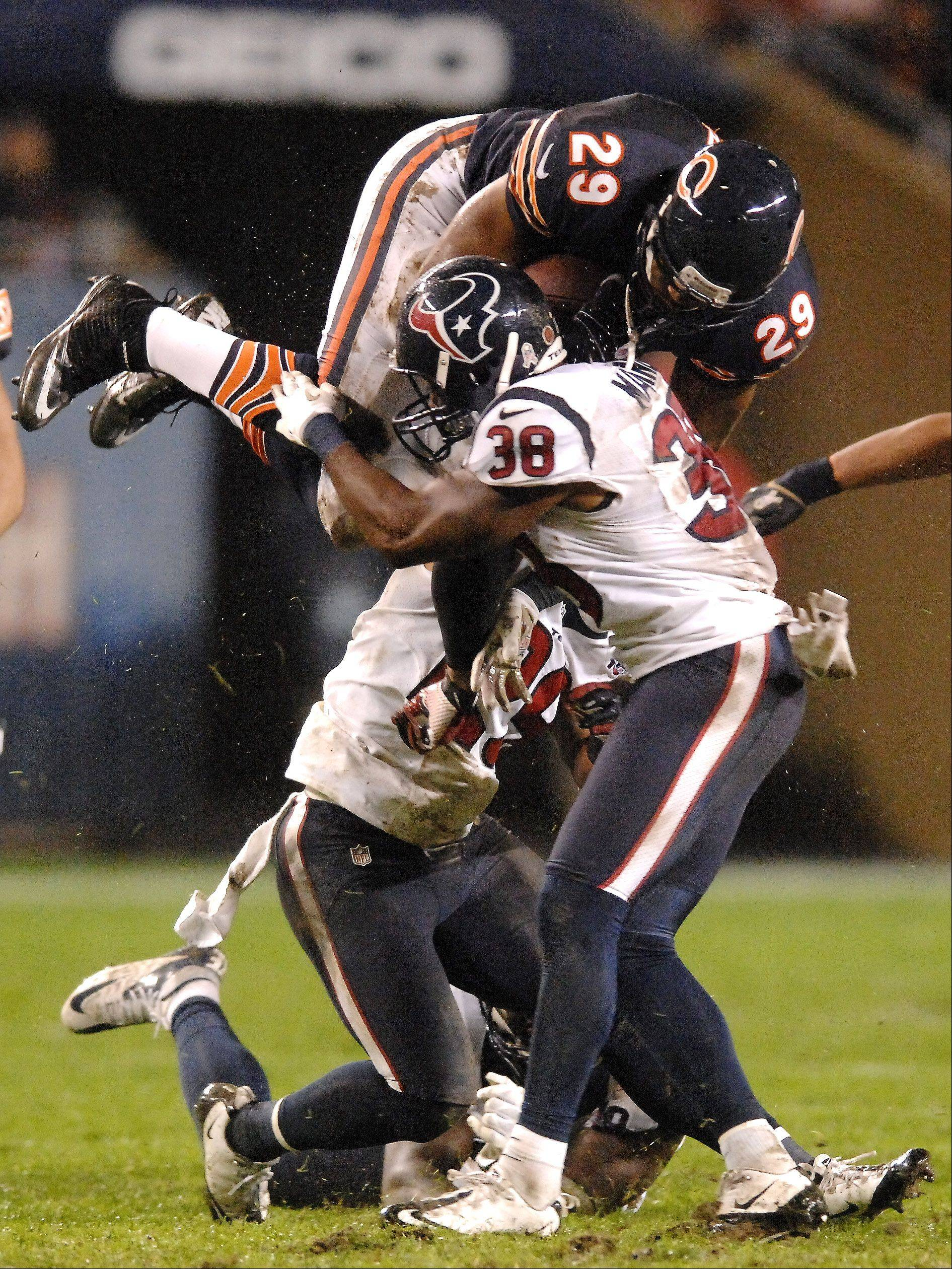 Chicago Bears running back Michael Bush (29) is upended on a 19-yard gain in the fourth quarter against Houston.