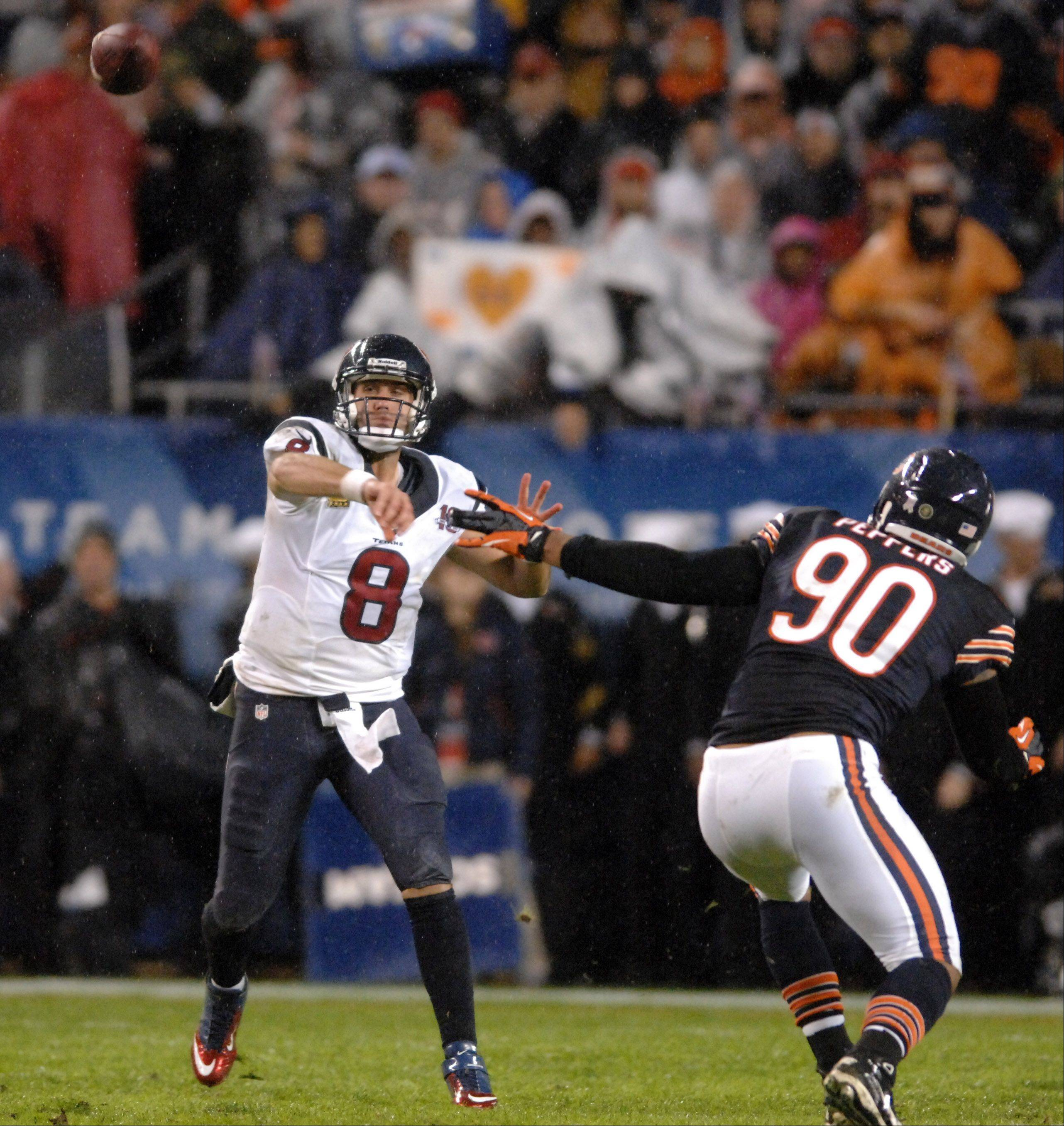 Houston Texans quarterback Matt Schaub (8) fires a pass that is intercepted the Chicago Bears cornerback Tim Jennings (26) during Sunday's game.