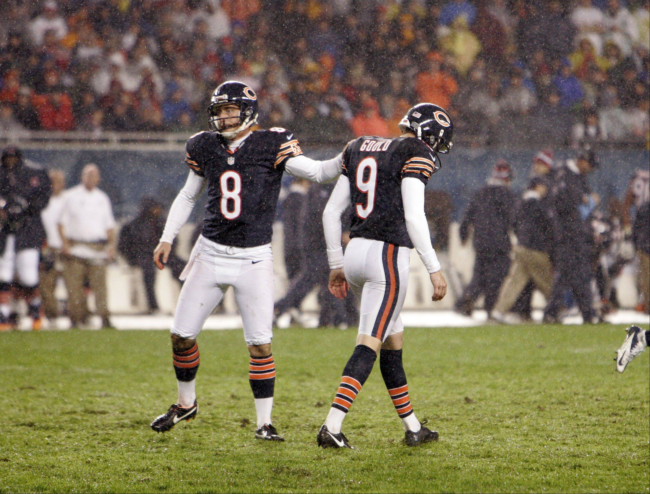 Chicago Bears punter Adam Podlesh (8) consoles Robbie Gould (9) after a missed field goal attempt during the game.