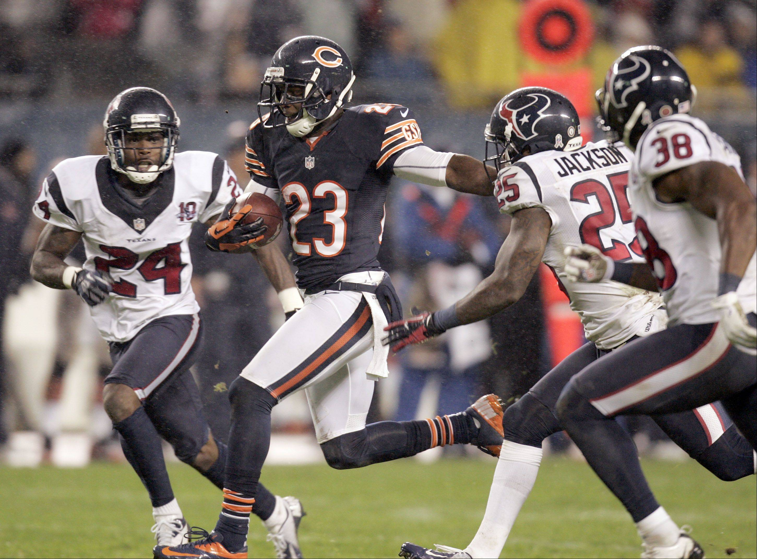 Chicago Bears wide receiver Devin Hester (23) splits Houston Texans cornerback Johnathan Joseph (24) and cornerback Kareem Jackson (25) on a play that was called back during the game Sunday November 11, 2012 at Soldier Field in Chicago.