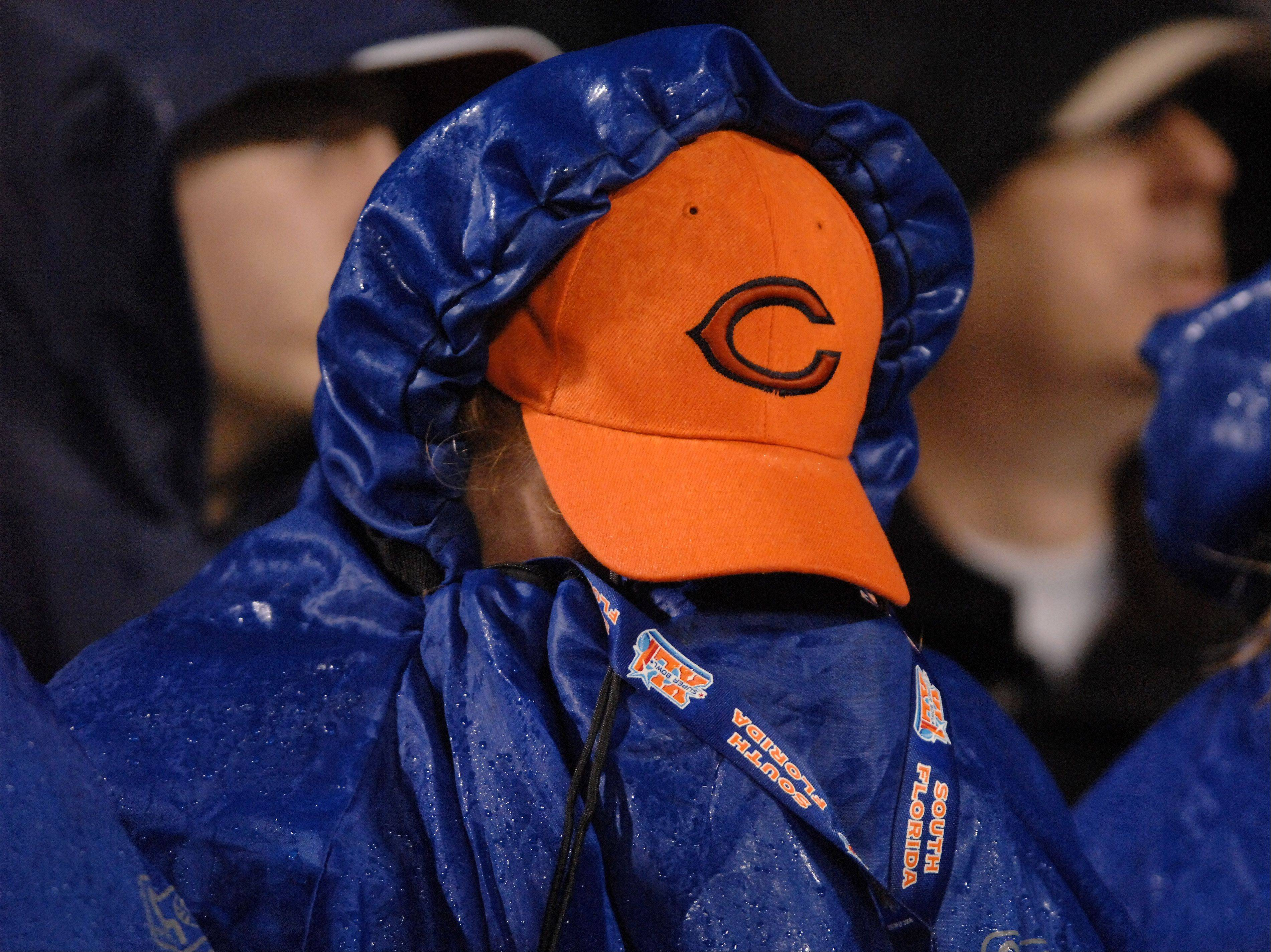A Bears fan can't bear to watch the final seconds during Sunday's loss to Houston at Soldier Field in Chicago.