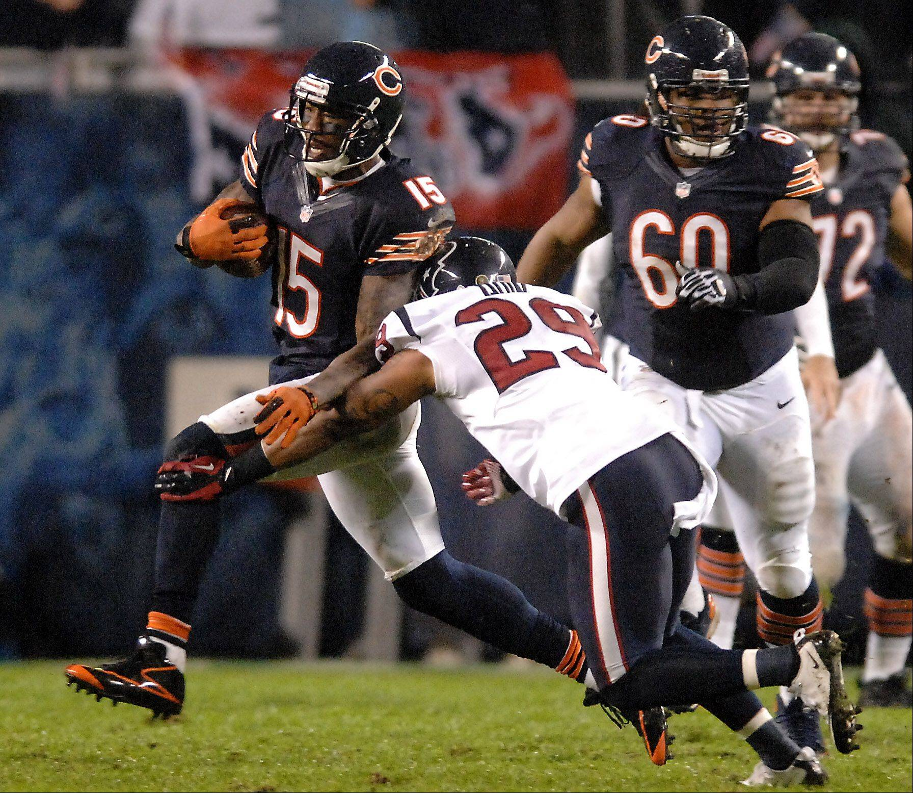 Chicago Bears wide receiver Brandon Marshall (15) breaks a tackle attempt by Houston Texans strong safety Glover Quin (29) during Sunday's game at Soldier Field in Chicago.