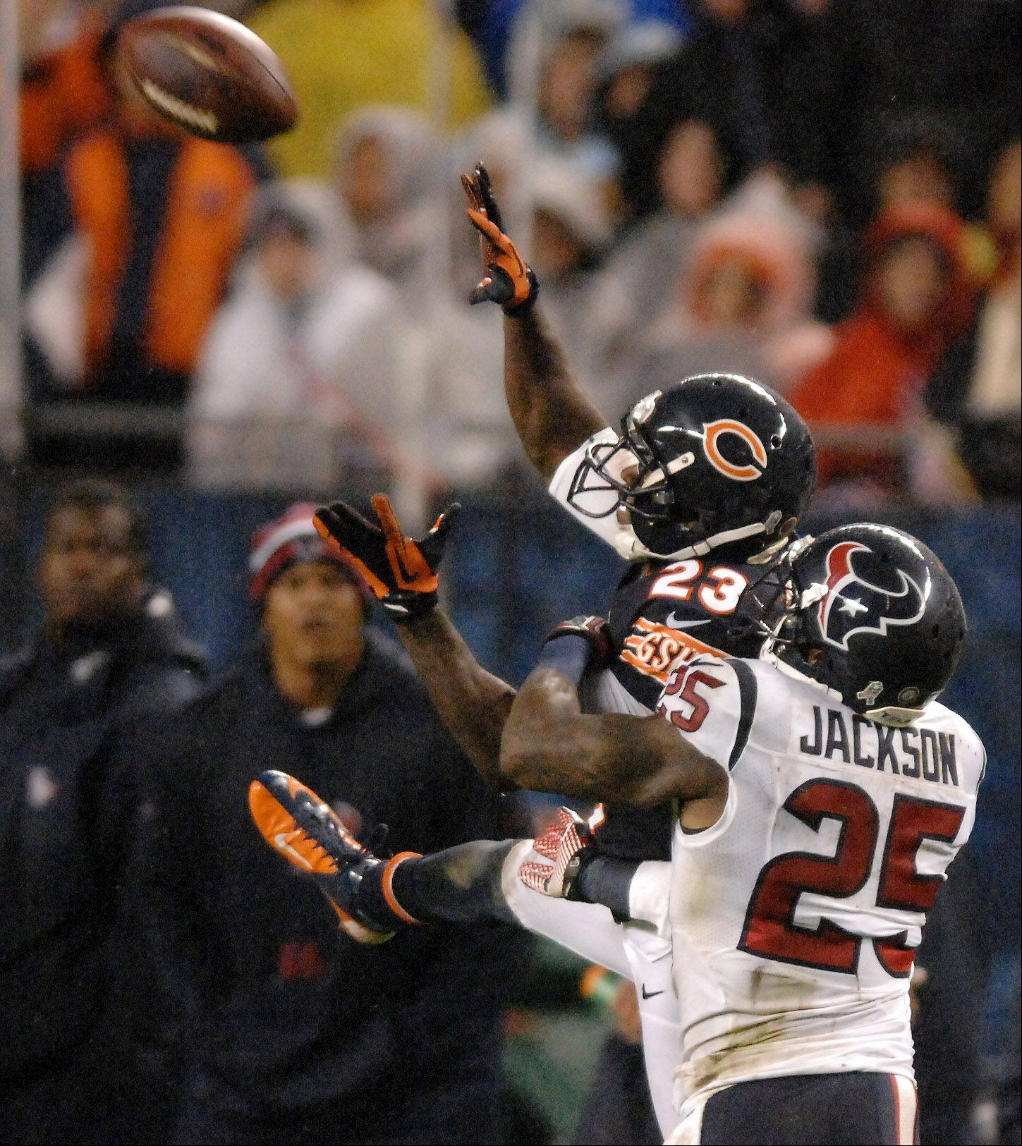 Houston Texans cornerback Kareem Jackson (25) breaks up a pass intended for Chicago Bears wide receiver Devin Hester (23) during Sunday's game at Soldier Field in Chicago.