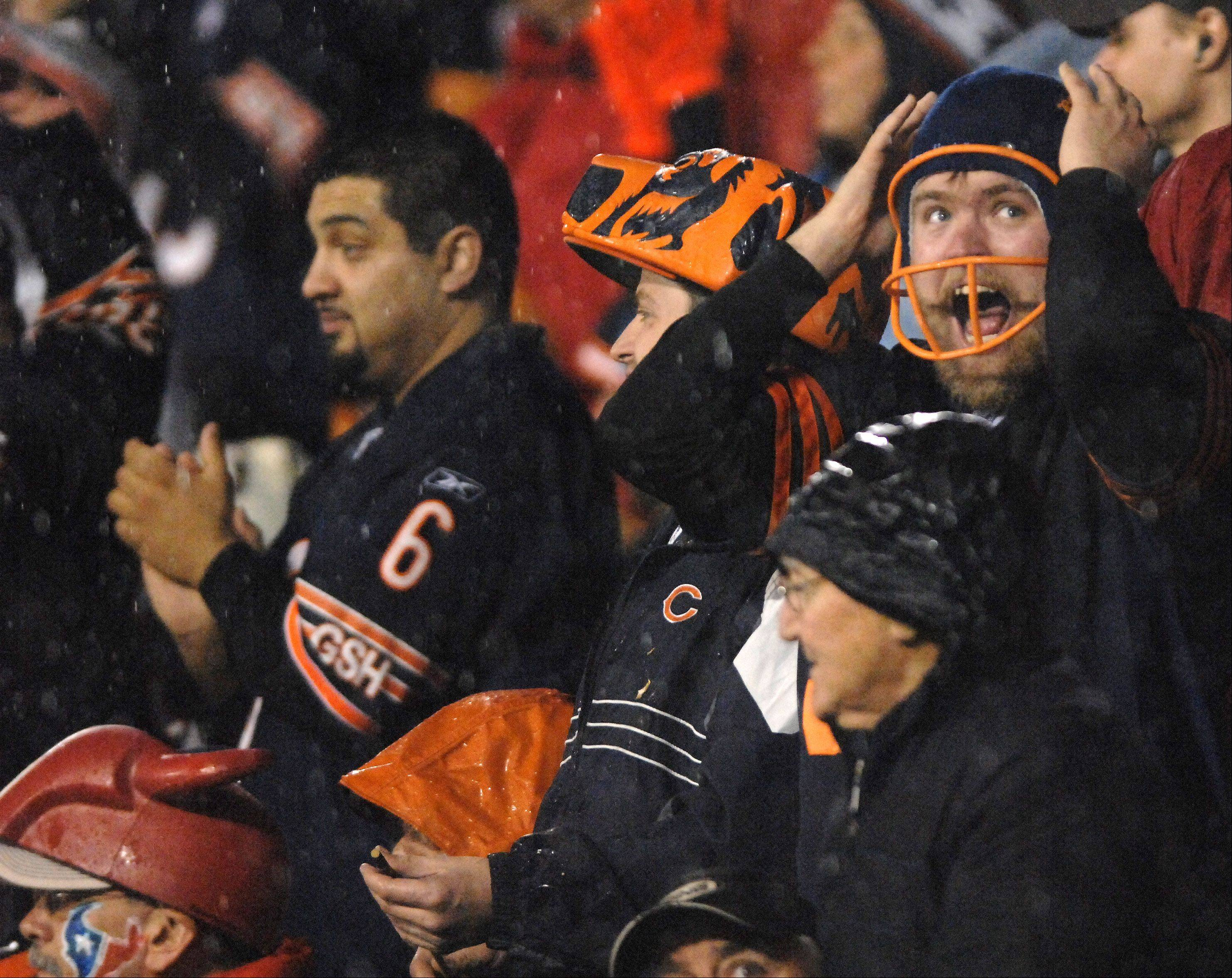 Bears fans react to the action during Sunday's game at Soldier Field in Chicago.