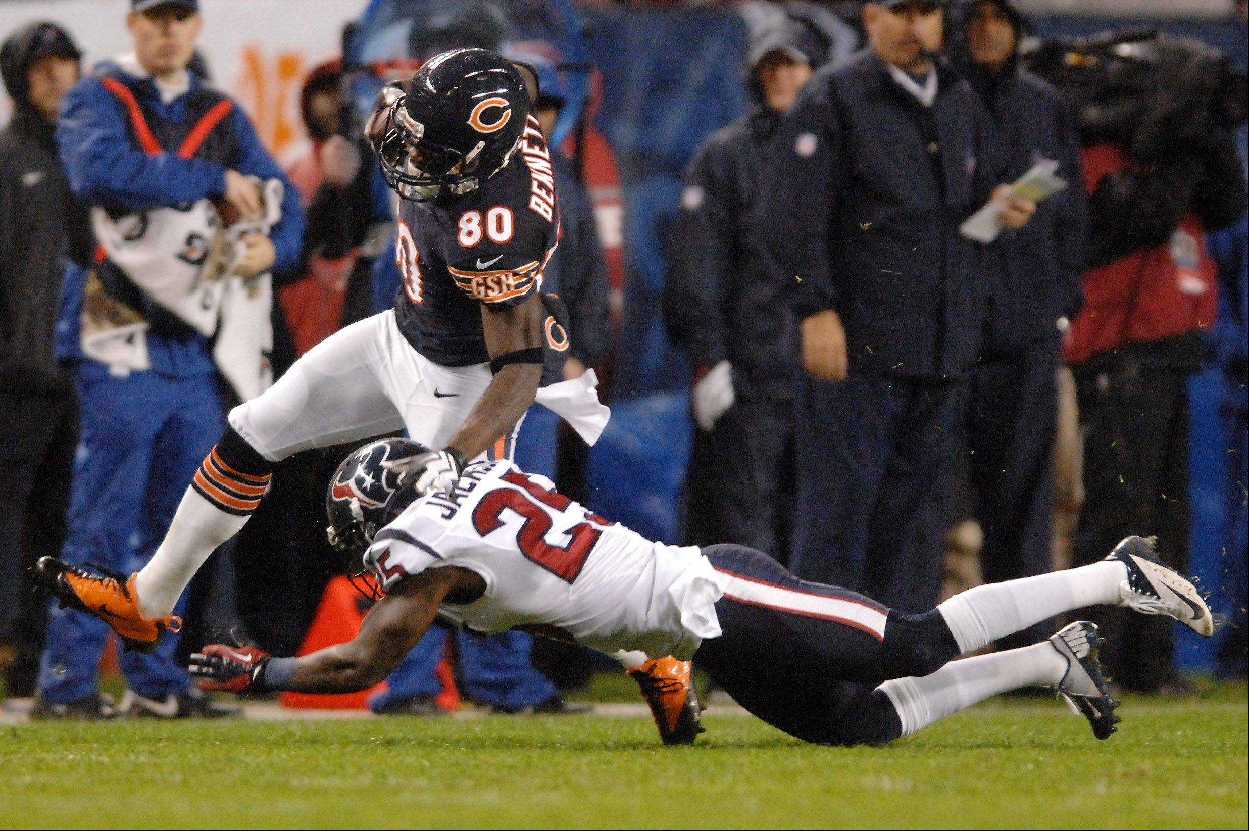 Chicago Bears wide receiver Earl Bennett (80) picks up some yards after the catch while breaking a tackle by Houston Texans cornerback Kareem Jackson (25) during Sunday's game.