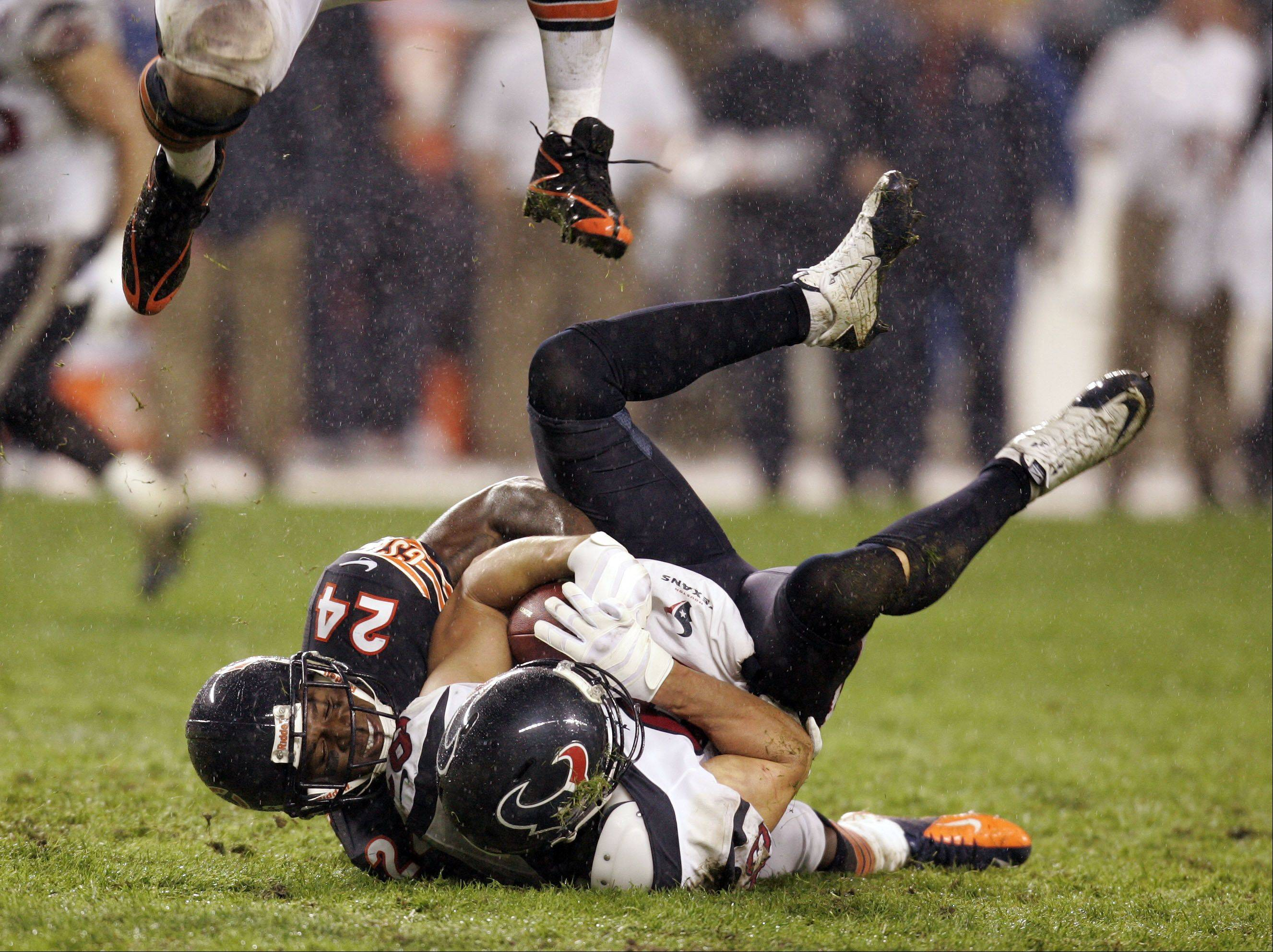 Chicago Bears cornerback Kelvin Hayden (24) pulls down Houston Texans wide receiver Kevin Walter (83) during the game.
