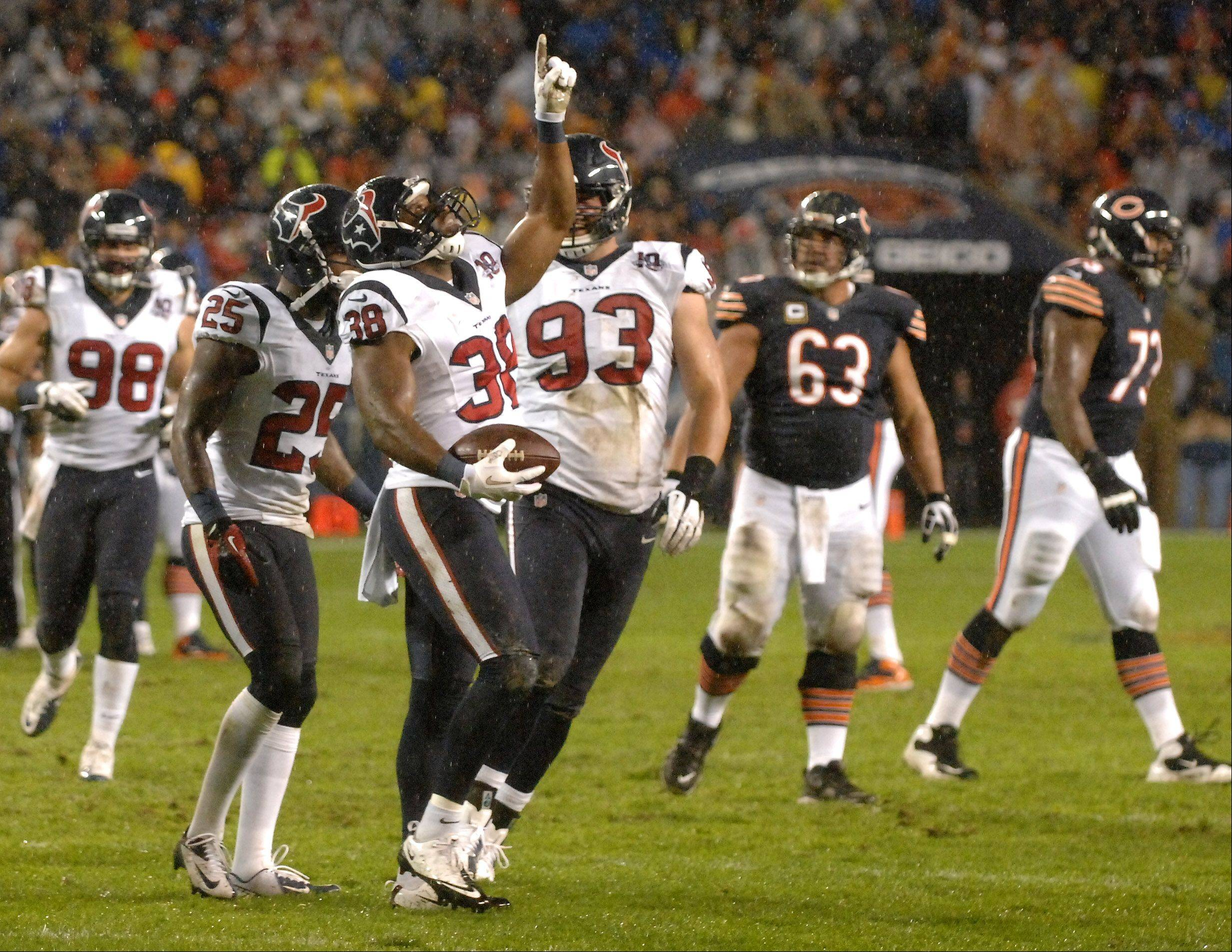 Houston Texans free safety Danieal Manning (38) points skyward after his first quarter interception.