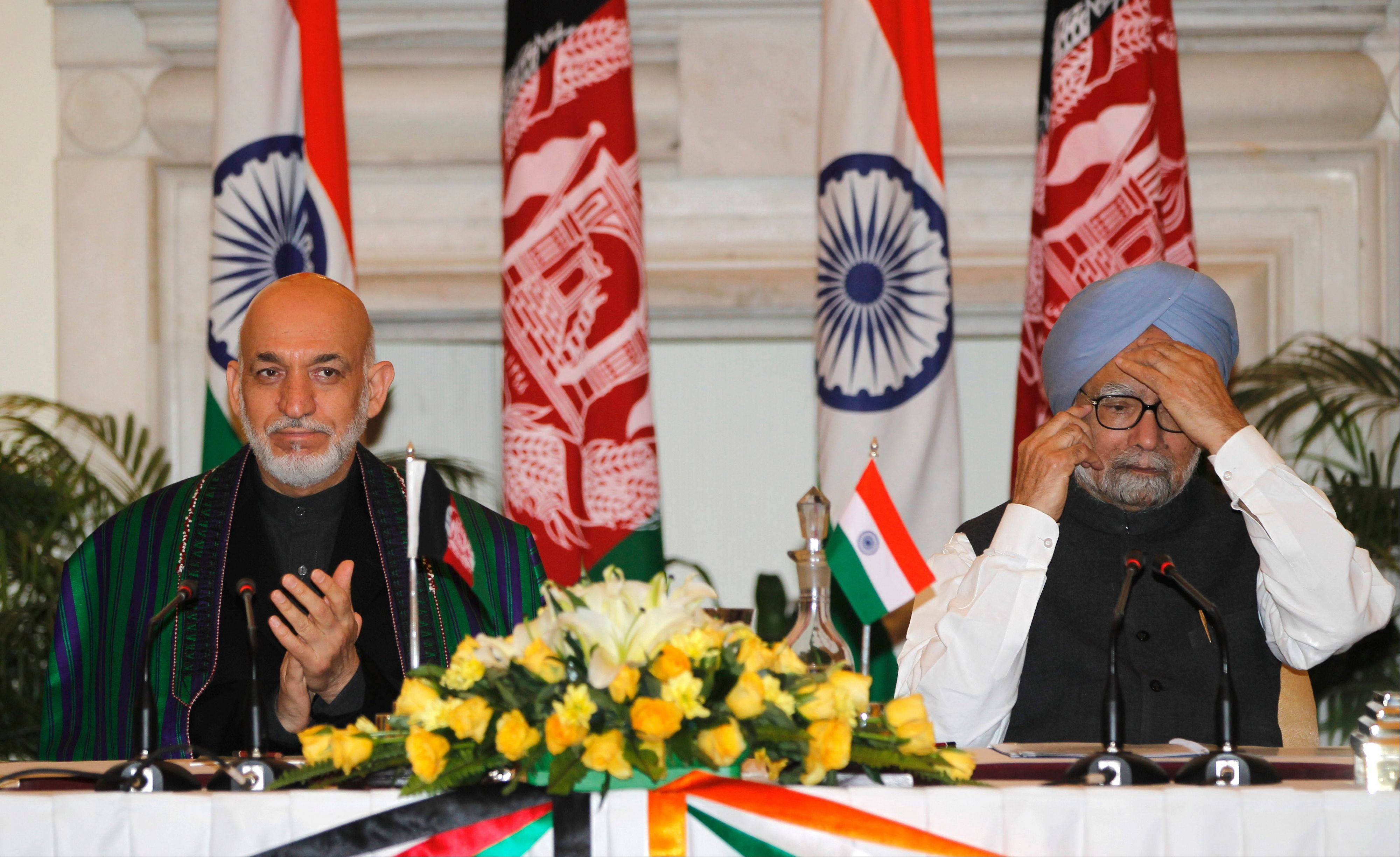 Afghanistan�s President Hamid Karzai, left, and Indian Prime Minister Manmohan Singh attend a ceremony of the signing of agreements between the two countries in New Delhi, India, Monday, Nov. 12, 2012. Karzai was meeting with Indian leaders Monday in a bid to woo investment to his war-torn country and boost security before a planned drawdown of NATO troops in 2014.
