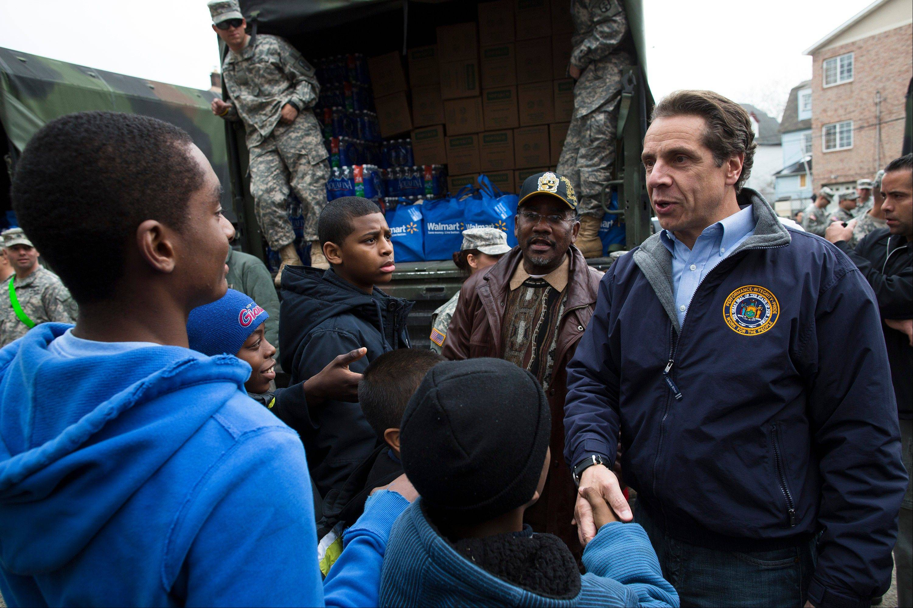 New York Governor Andrew Cuomo greets residents of the Far Rockaways section of the Queens borough of New York, Saturday. An administration official says Gov. Andrew Cuomo plans to request at least $30 billion in federal disaster aid to rebuild after Superstorm Sandy.