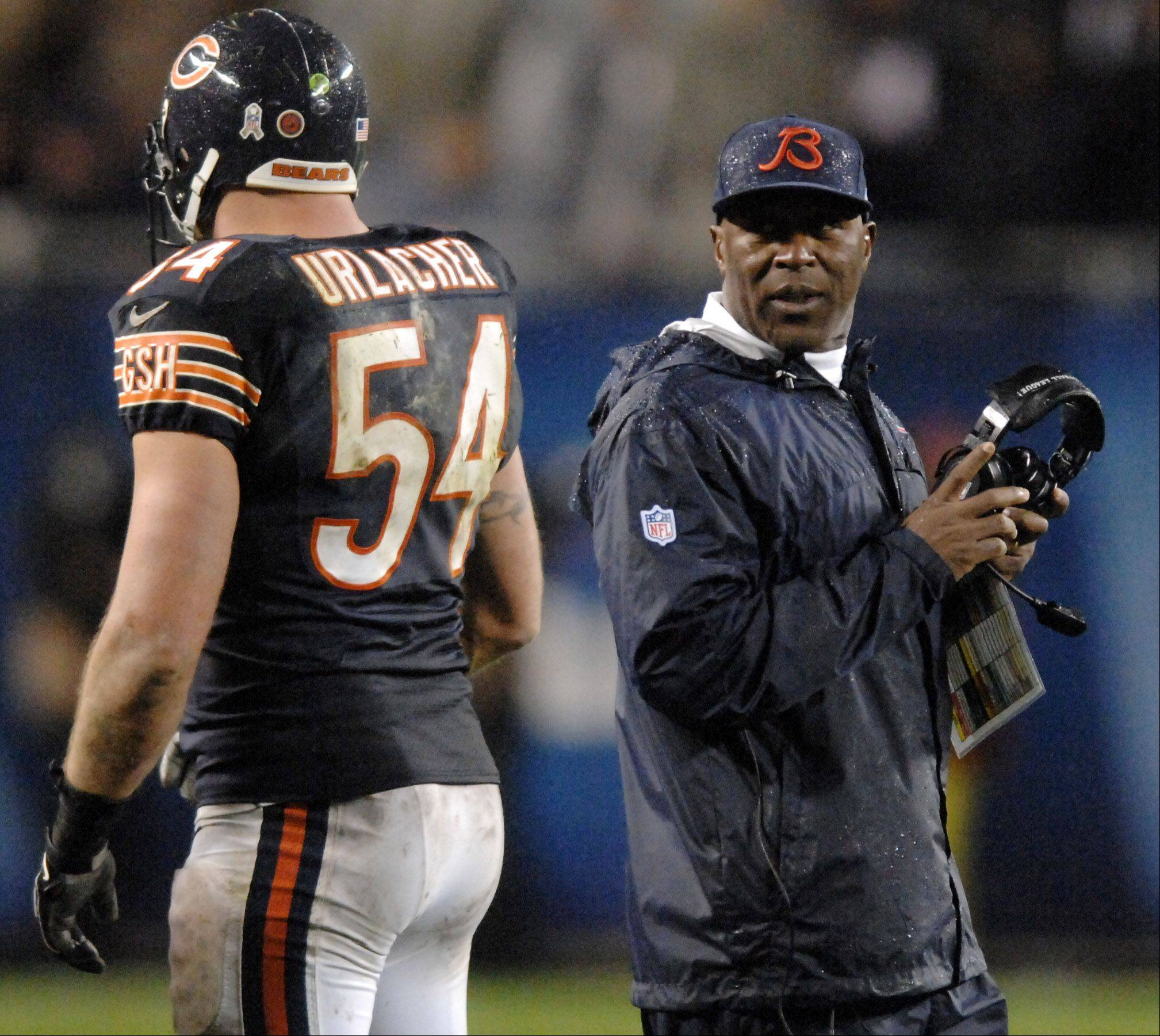 Chicago Bears head coach Lovie Smith has a word with linebacker Brian Urlacher (54) in the second half during Sunday�s game at Soldier Field in Chicago.