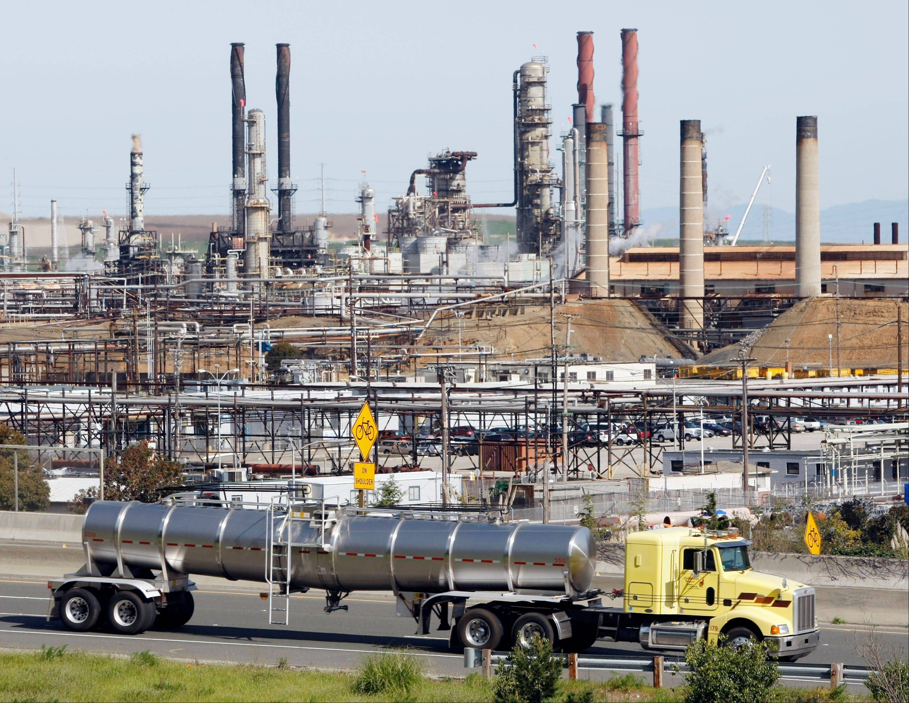 "This is the Chevron oil refinery in Richmond, Calif. California's largest greenhouse gas emitters will for the first time begin buying permits in a landmark ""cap-and-trade"" system meant to control emissions of heat-trapping gases and spur investment in clean technologies."