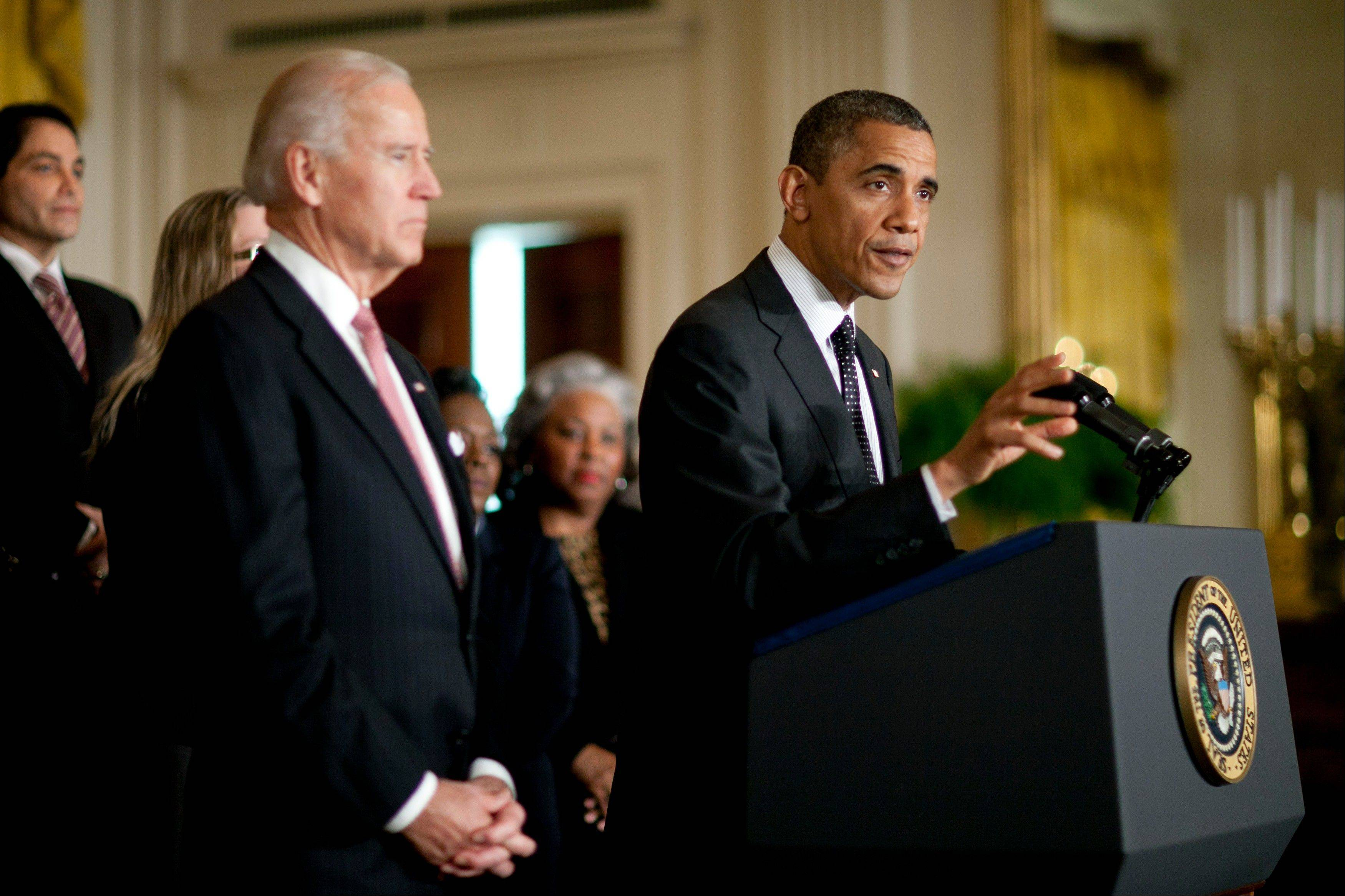 "U.S. President Barack Obama, right, speaks while U.S. Vice President Joseph ""Joe"" Biden listens in the East Room of the White House in Washington, D.C., U.S., on Friday, Nov. 9, 2012. Obama is urging quick action by Congress to keep taxes from rising on middle-income Americans at the start of the new year and begin negotiations to avert automatic spending cuts."