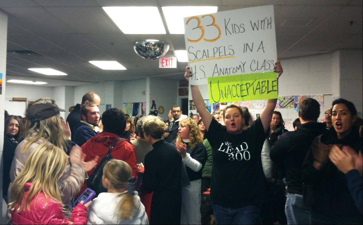 Dozens of teachers, parents and supporters showed up at the District 300 board meeting, overflowing into the hallways, to protest large class sizes.