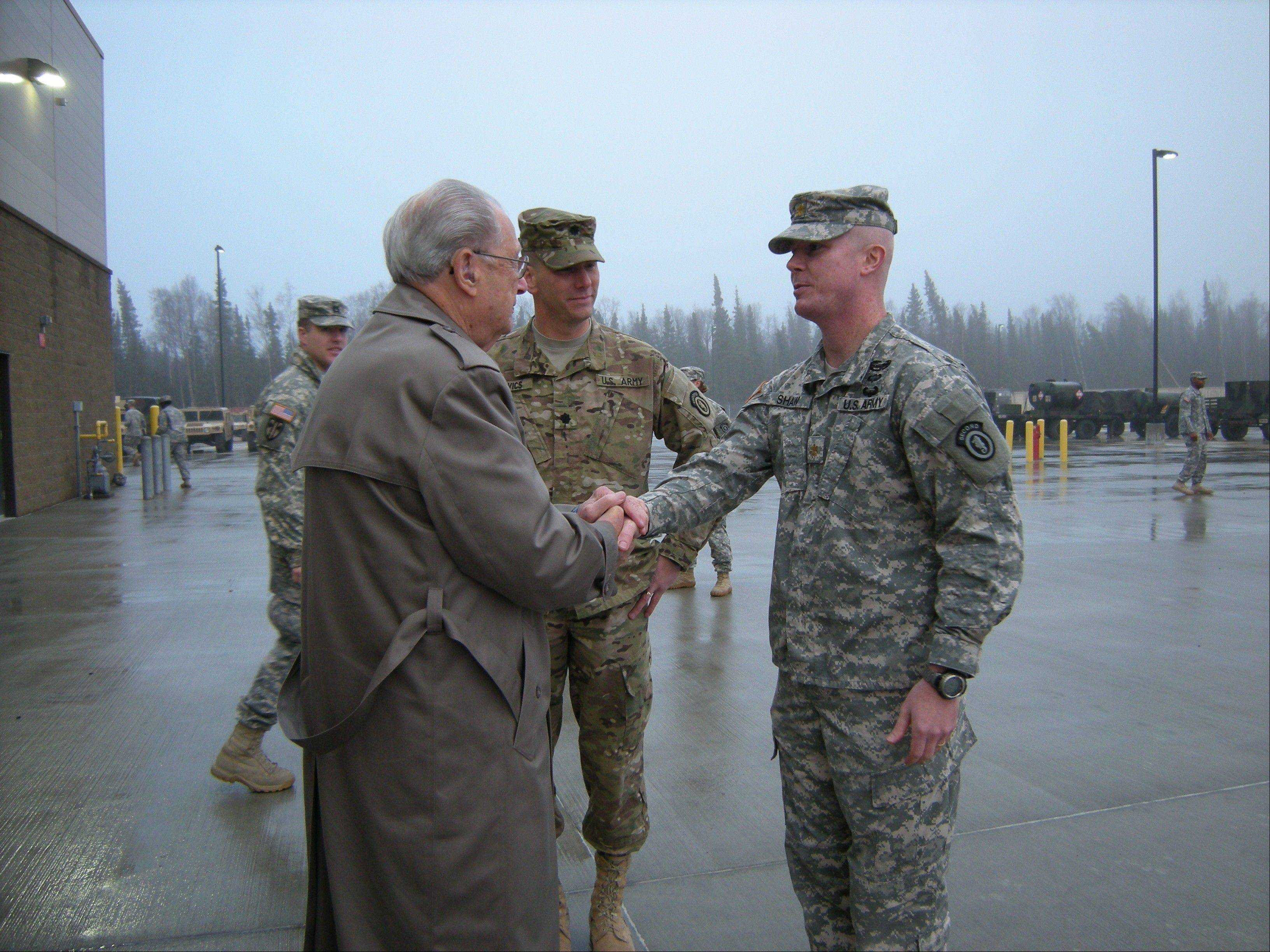 Frank DeRosa greets Lt. Col. Stephen Gabavics and Major John Shaw at the base in Alaska.