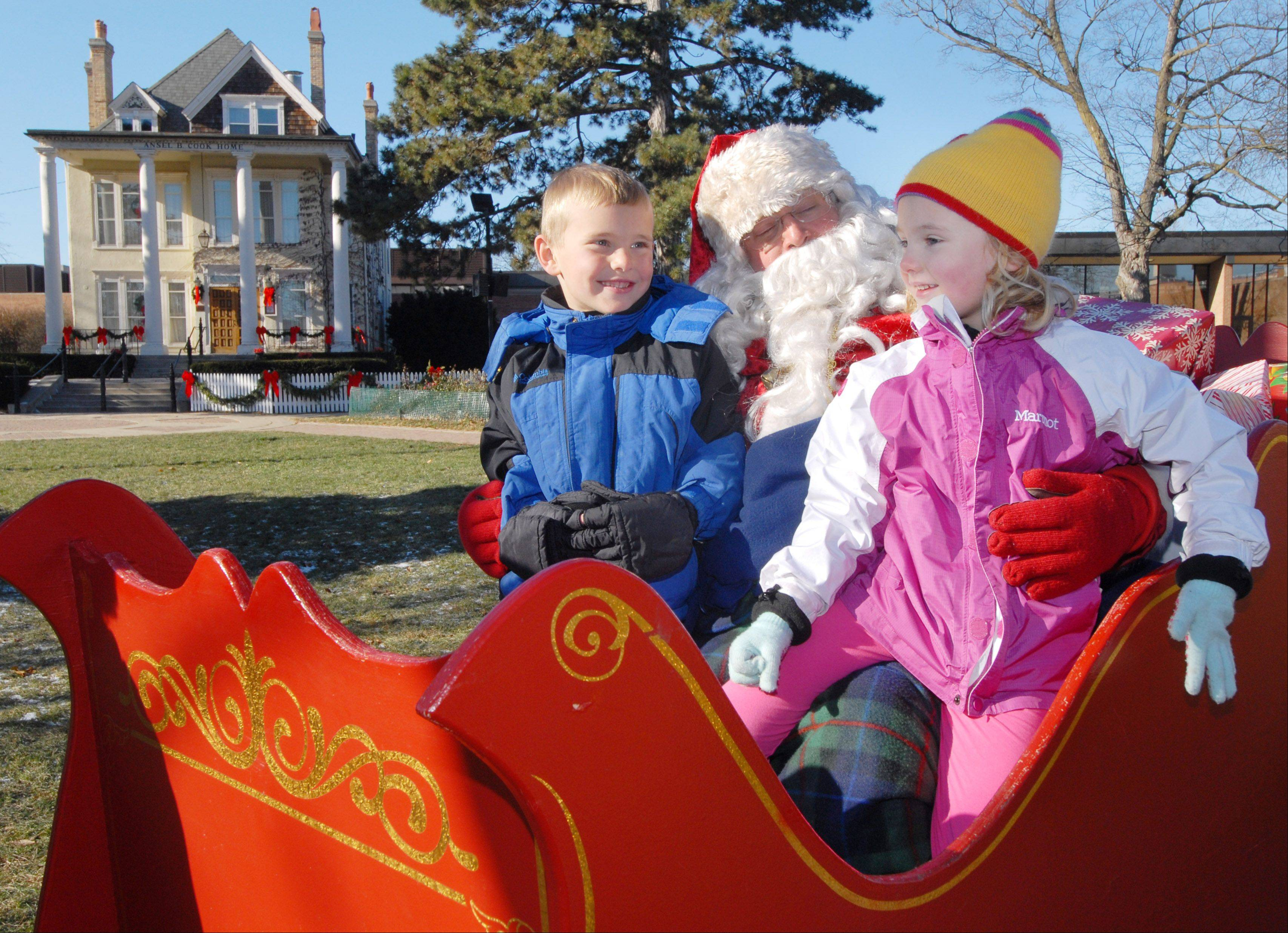 "Santa visits with children in his sleigh during last year's ""Dickens of a Holiday"" in Libertyville."