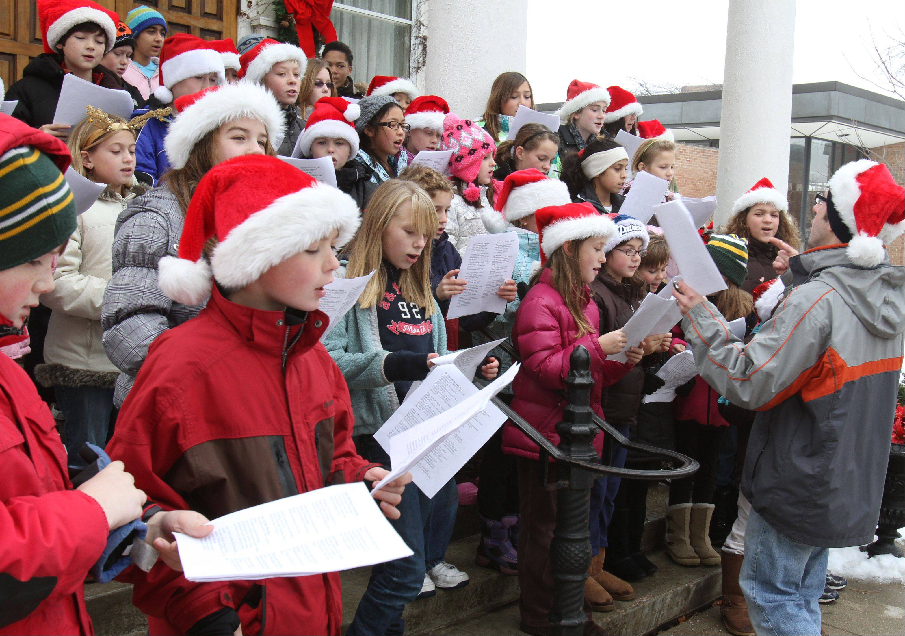 "Oak Grove School students sing during Libertyville's ""Dickens of a Holiday"" in Cook Park."