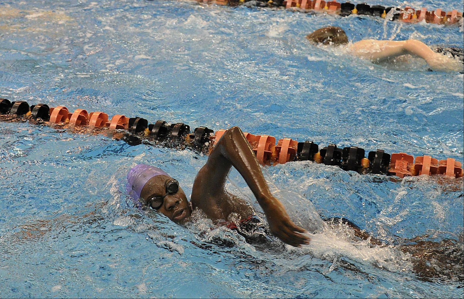 Llori Sharpe, 12, of the Jamaica Tornadoes Swim Club powers through a lap during practice Friday with the Barrington Swim Club at Barrington High School.
