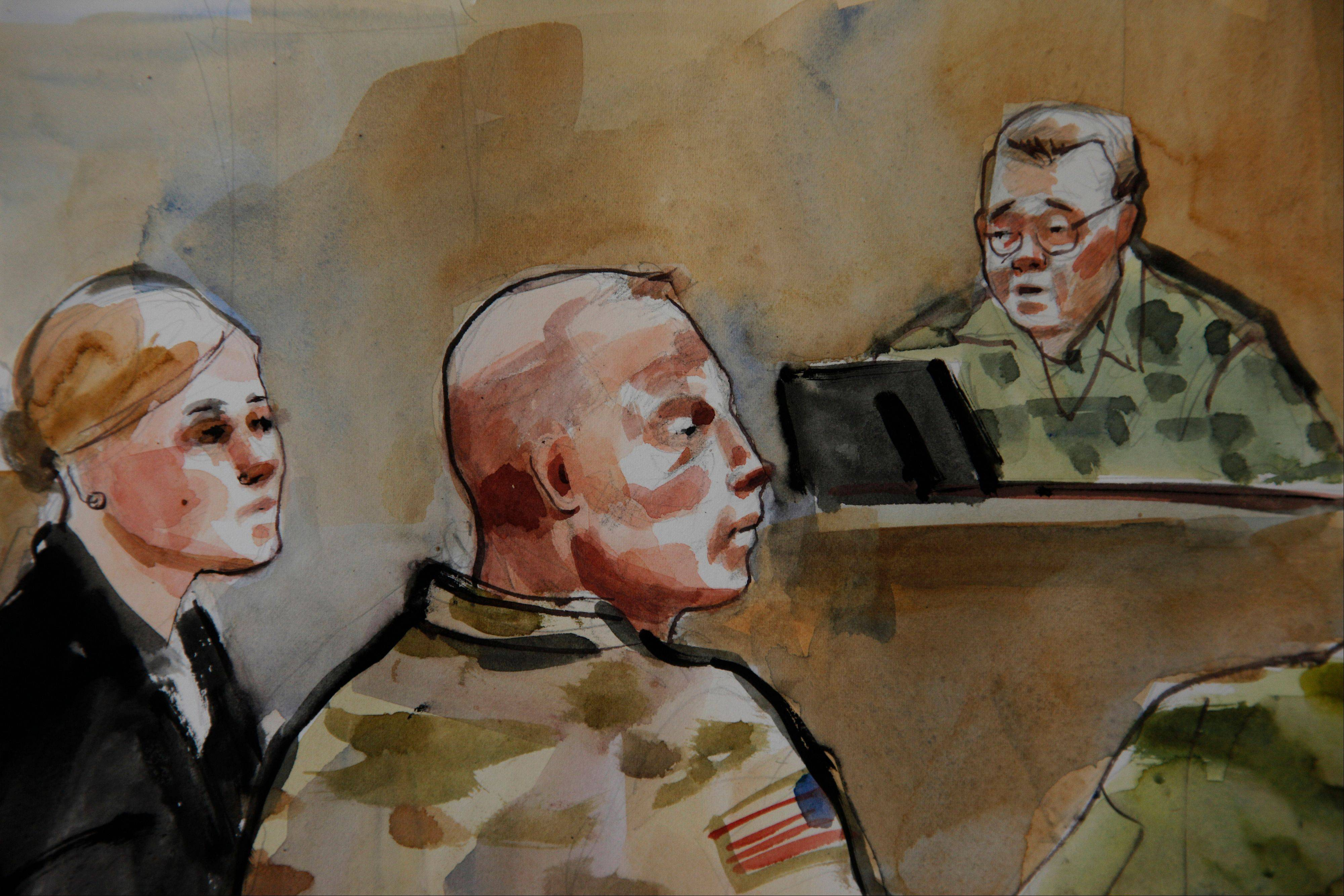 U.S. Army Staff Sgt. Robert Bales, center, is shown Monday, Nov. 5, during a preliminary hearing in a military courtroom at Joint Base Lewis McChord in Washington state. An Afghan National Army guard who reported seeing a U.S. soldier outside a remote base the night 16 civilians were massacred in March said the man did not stop even after being asked three times to do so. The guard, named Nematullah, testified by live video from Kandahar, Afghanistan, on Friday Nov. 9, during an overnight session for a hearing in the case against Staff Sgt. Robert Bales.