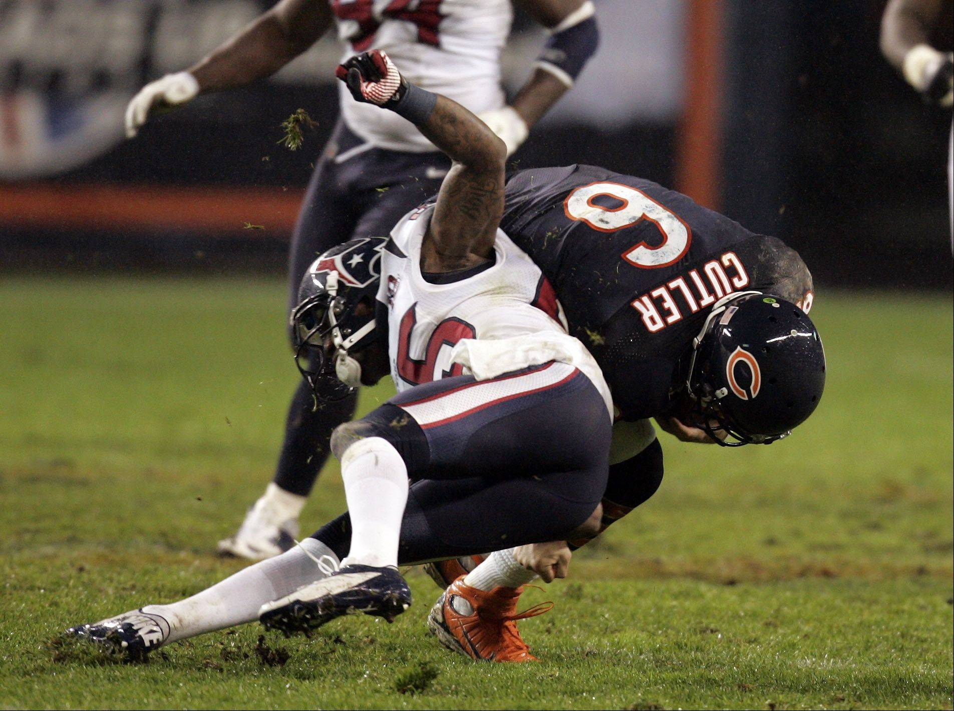 Chicago Bears quarterback Jay Cutler (6) gets hit hard by Houston Texans cornerback Kareem Jackson (25) late in the first half during the game Sunday November 11, 2012 at Soldier Filed in Chicago.