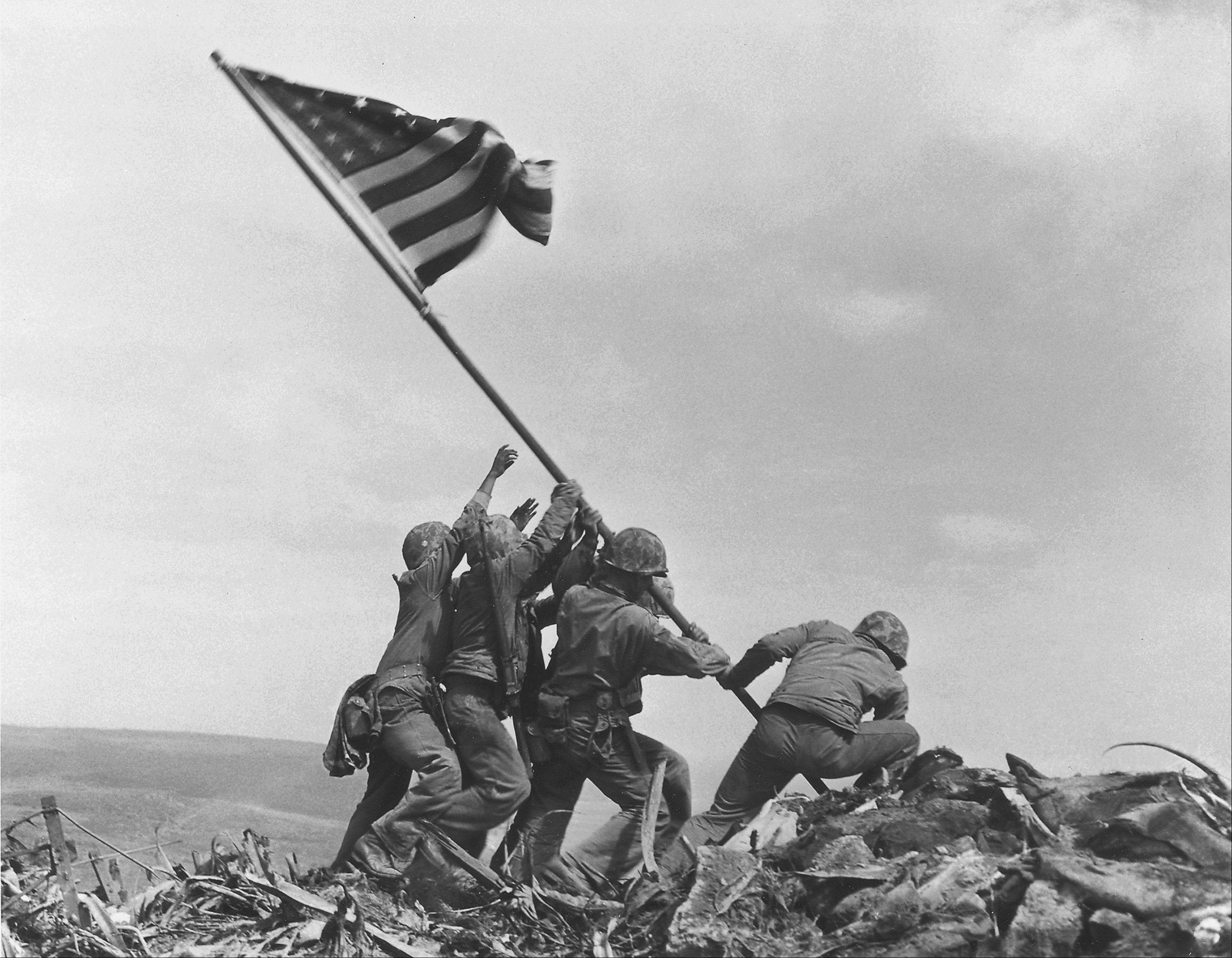 U.S. Marines of the 28th Regiment, 5th Division, raise the American flag atop Mt. Suribachi, Iwo Jima, on Feb. 23, 1945 during World War II.