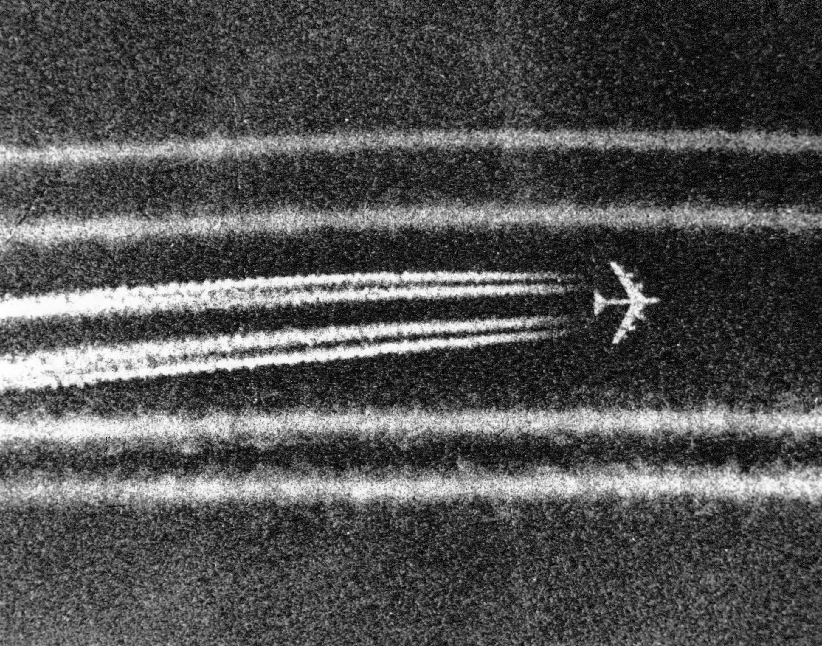 B52 high altitude bombers leave condensation trails while passing the town of Cai Lay in the Mekong Delta on Sept. 29, 1972, moments after unleashing bombs on a suspected enemy positions.