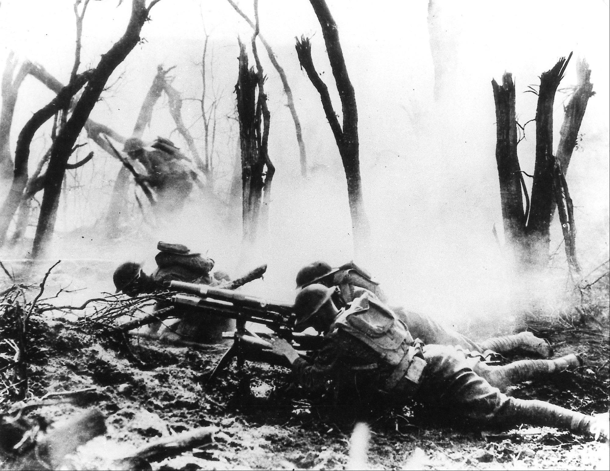 American infantrymen fire a 37mm gun at a German position in France during World War I.