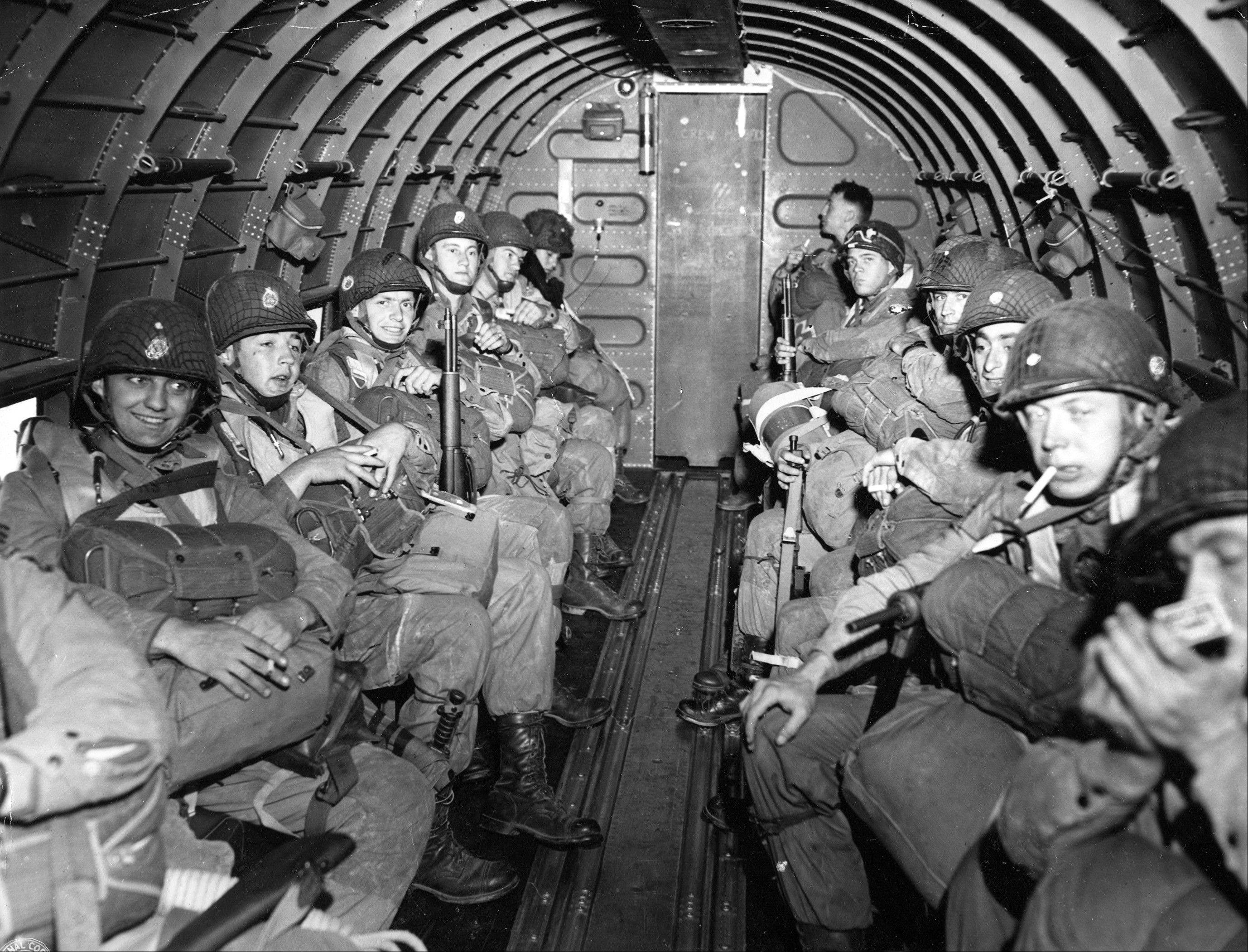 American Paratroopers fly over the English Channel enroute to play a key role in the invasion of France by landing along a 100 mile front of the Normandy coast on June 6, 1944.