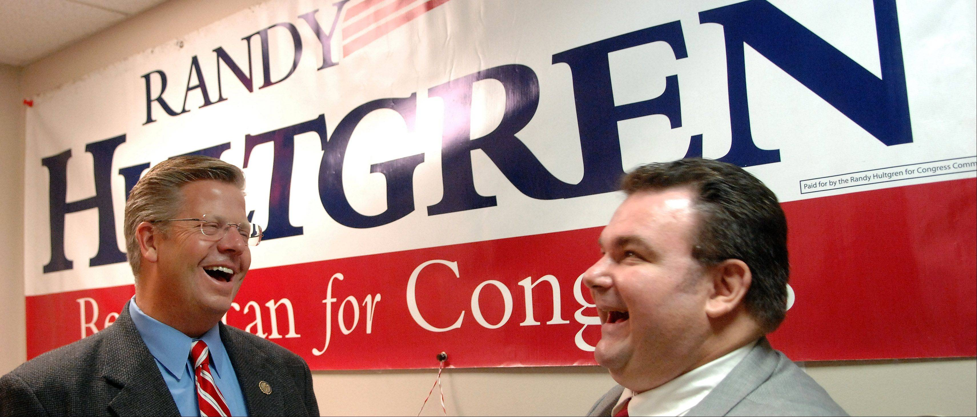 Rep. Randy Hultgren talks with supporter John O'Neill of McHenry at his campaign headquarters in St. Charles Tuesday night.