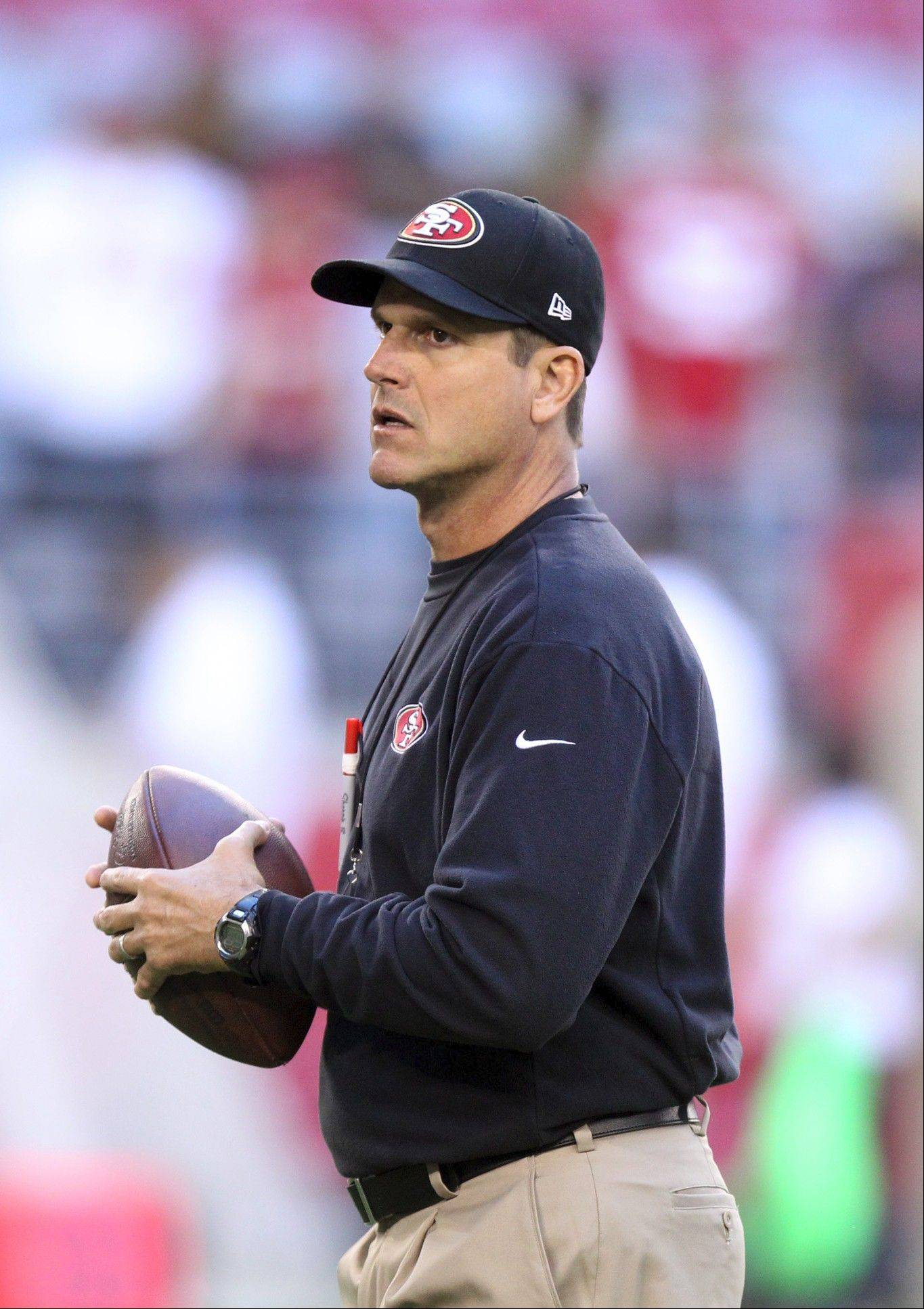 San Francisco 49ers coach Jim Harbaugh is seen throwing the ball prior to facing the Arizona Cardinals in an NFL football game Monday, Oct. 29, 2012, in Glendale, Ariz.