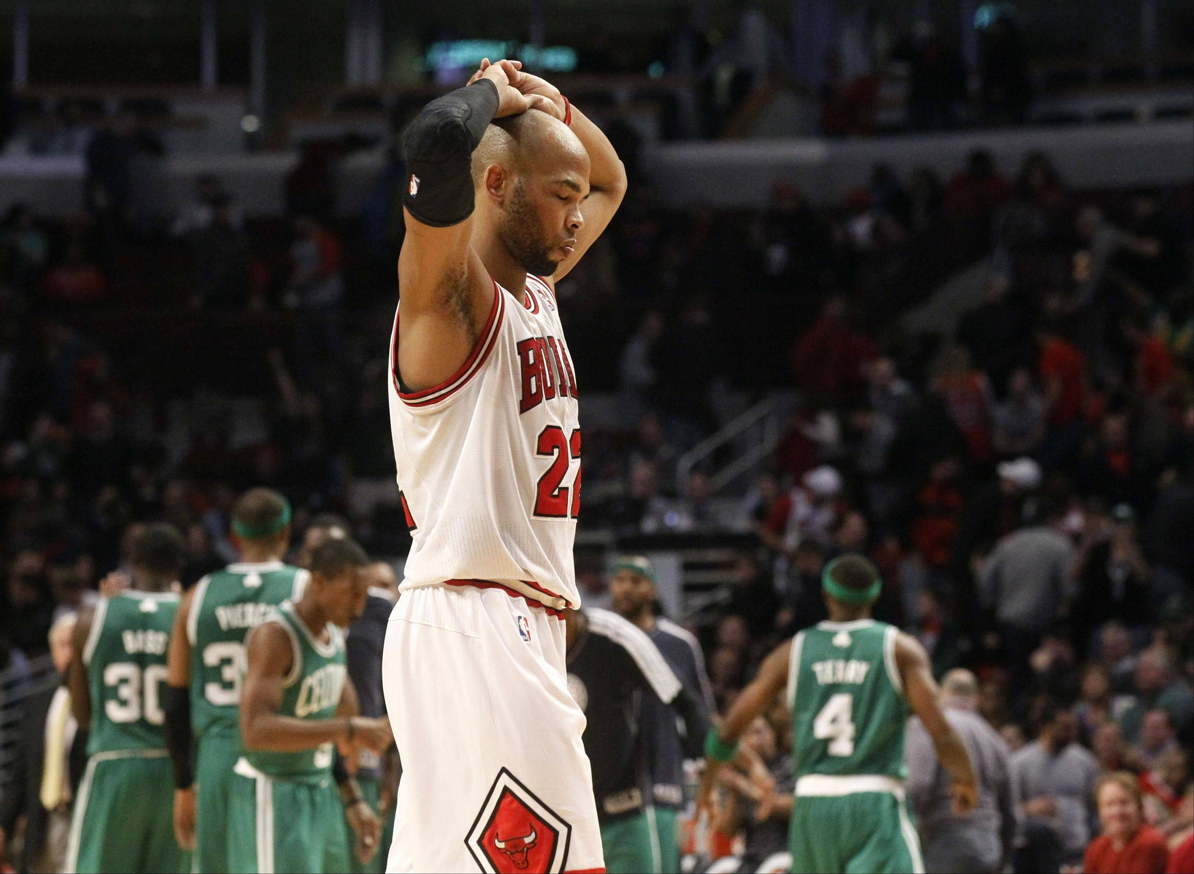 Bulls forward Taj Gibson walks back to the bench during a time out during the closing seconds of Monday's loss to the Celtice at United Center.