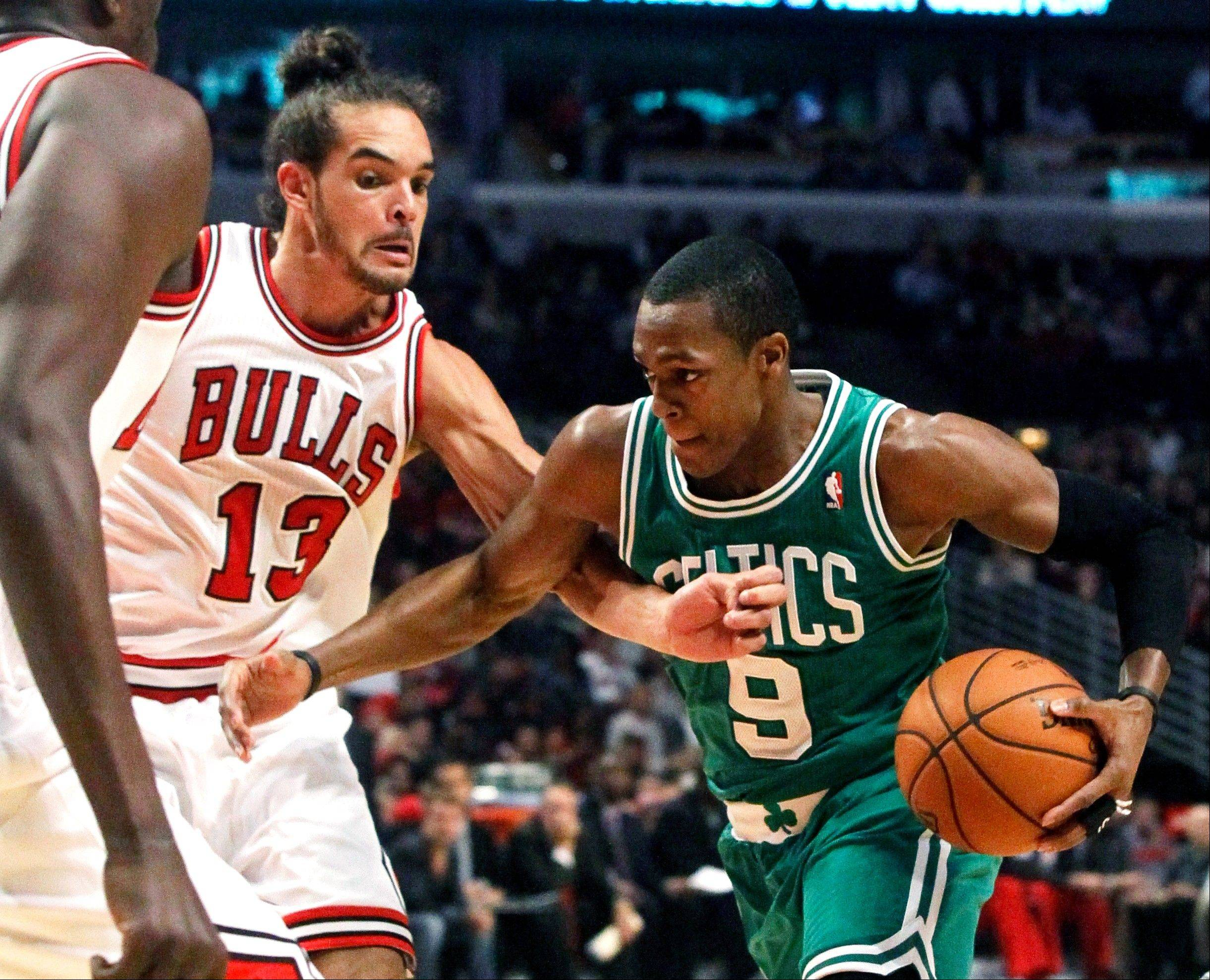 Boston Celtics guard Rajon Rondo (9) drives on Chicago Bulls center Joakim Noah during the first half of an NBA basketball game, Monday, Nov. 12, 2012, in Chicago.